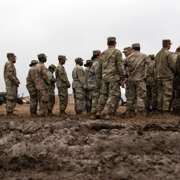 U.S. Army troops deployed to the U.S.-Mexico border line up to receive a Thanksgiving meal at a base near the Donna-Rio Bravo International Bridge on Nov. 22, 2018 in Donna, Texas. (Credit: Tamir Kalifa/Getty Images)