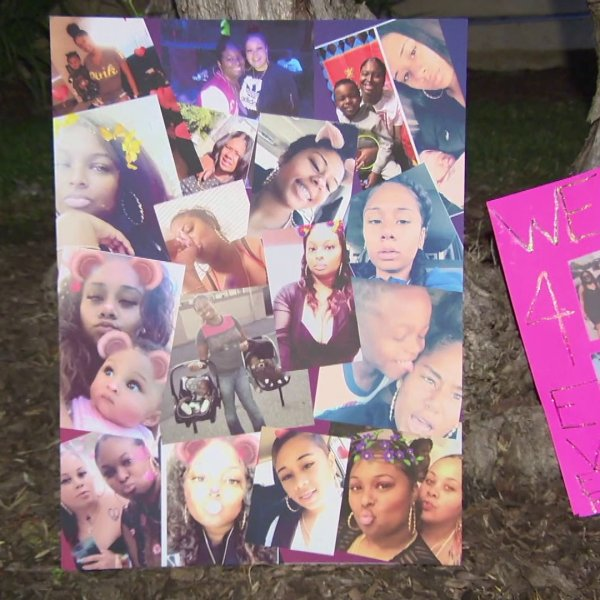 Photos of two sisters who died in a shooting and arson fire at their Westchester apartment on Nov. 17, 2018, are displayed at a vigil on Nov. 18, 2018.