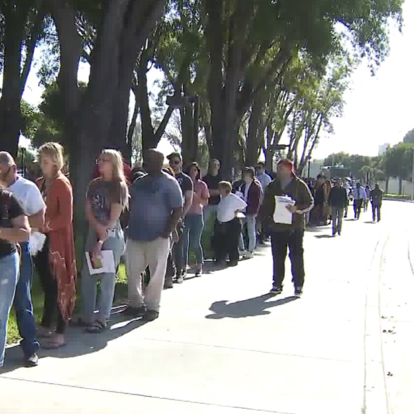 People line up to register to vote and cast their ballots on Nov. 6, 2018, in Norwalk. The registrar's office there allows people to register on Election Day. (Credit: KTLA)
