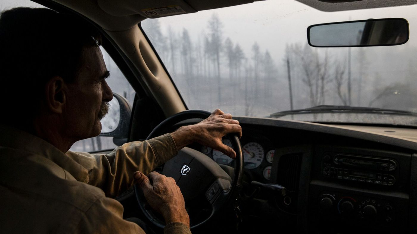 Jeff Evans drives through Concow with a list of places to check on after the Camp Fire in November 2018. (Credit: Kent Nishimura / Los Angeles Times)