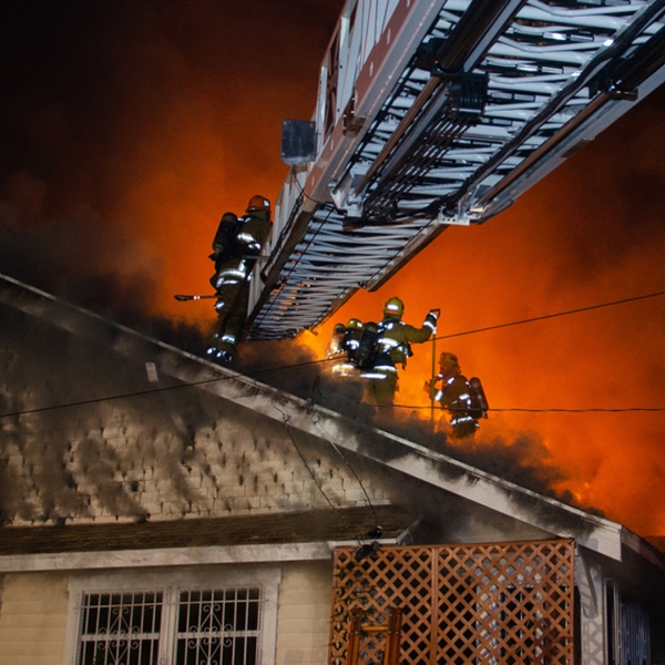 Los Angeles Fire Department firefighters battle a house fire in the Vermont Square neighborhood of Los Angeles on Dec. 23, 2018. (Credit: Brandon Buckley/ LAFD)