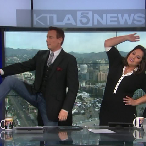 Chris Burrous and Lynette Romero do the 8:38 stretch during the KTLA 5 Weekend Morning News in this undated photo. (Credit: KTLA)