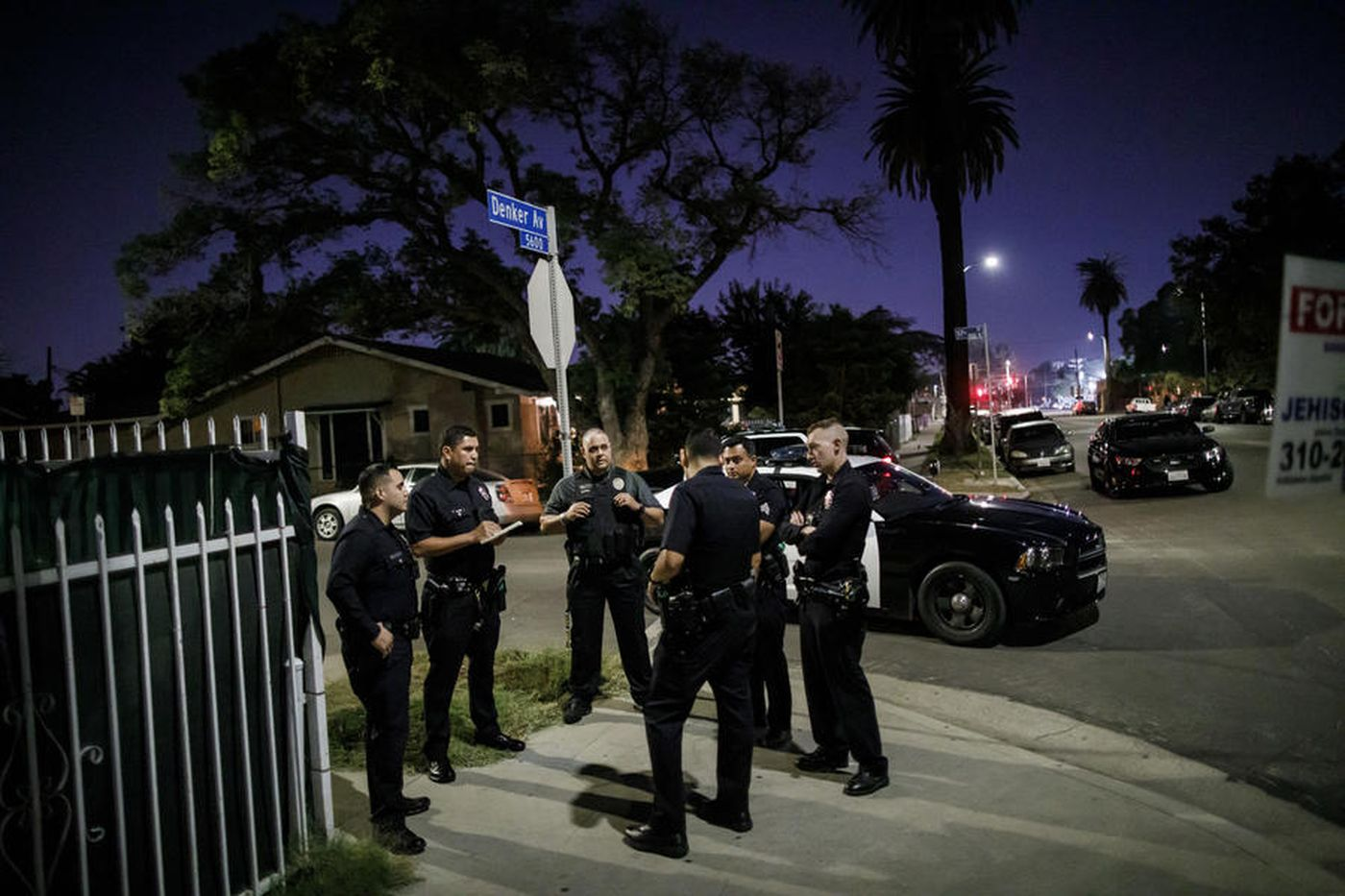 Los Angeles Police Department officers are seen on the corner of Denker Avenue in South L.A. in this undated photo. (Credit: Marcus Yam / Los Angeles Times)