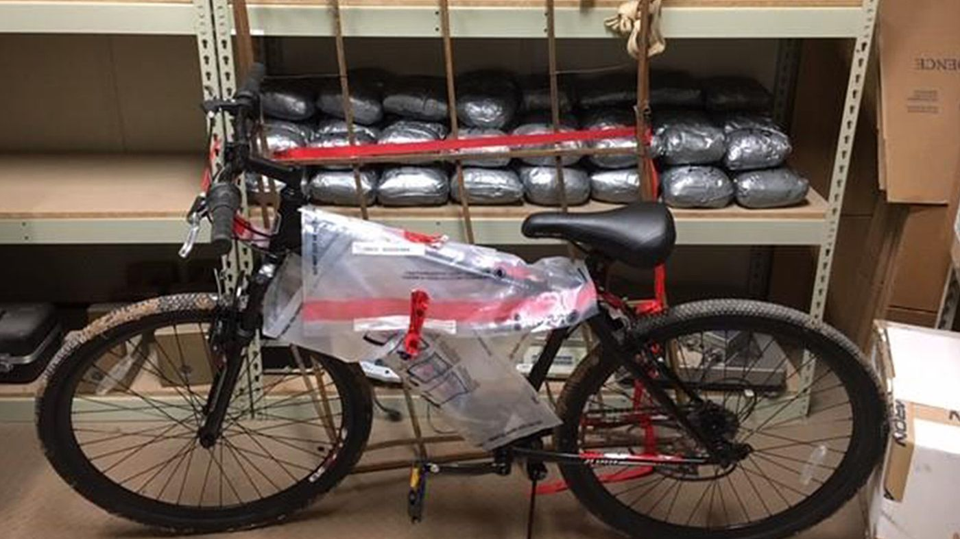 Duct-taped bundles and a bicycle were among items that agents found under heavy brush near Calexico on Dec. 16, 2018. (Credit: U.S. Customs and Border Patrol)