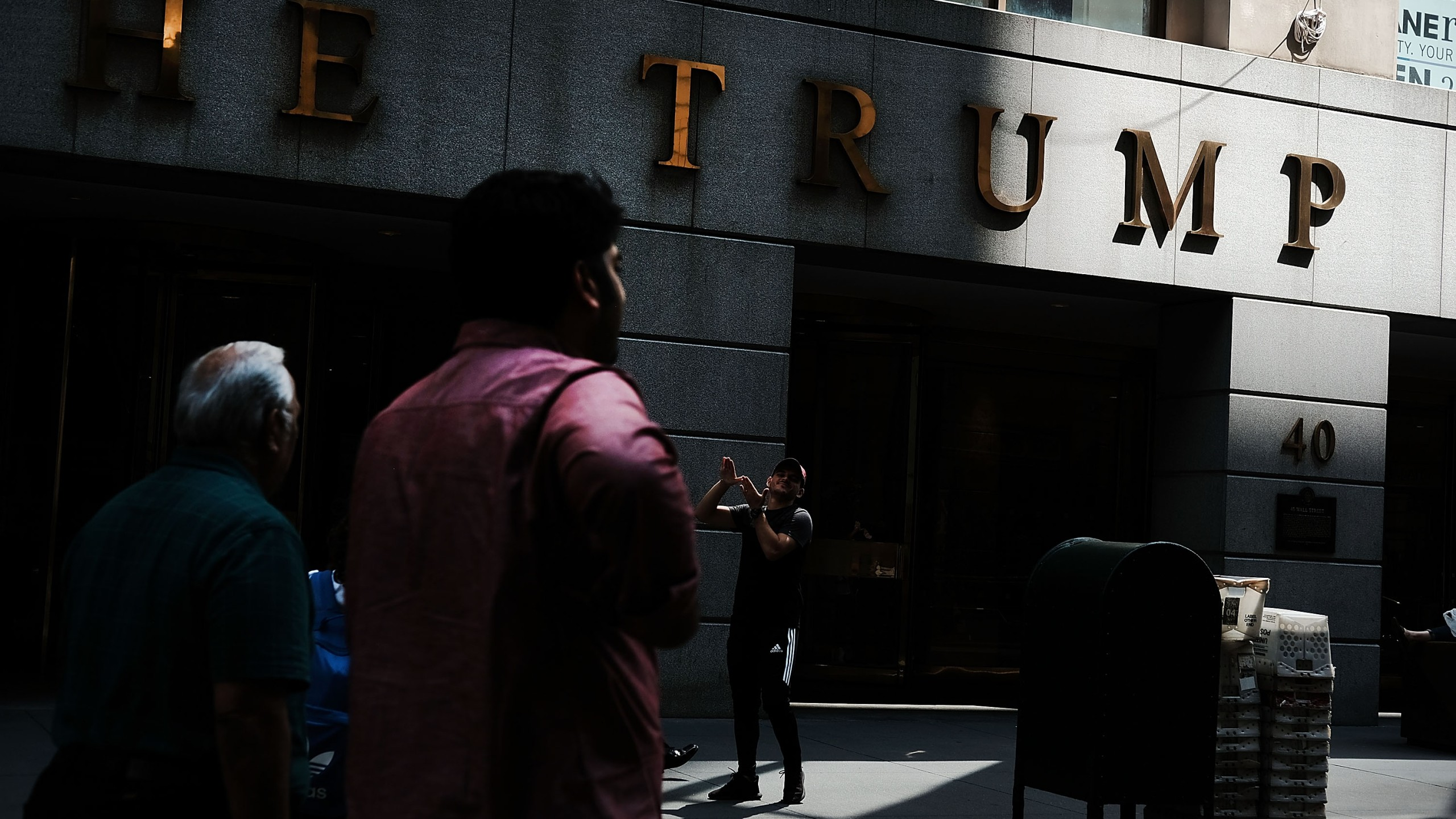 People walk outside of a building owned by President Donald Trump in Manhattan on August 24, 2018 in New York City. (Credit: Spencer Platt/Getty Images)