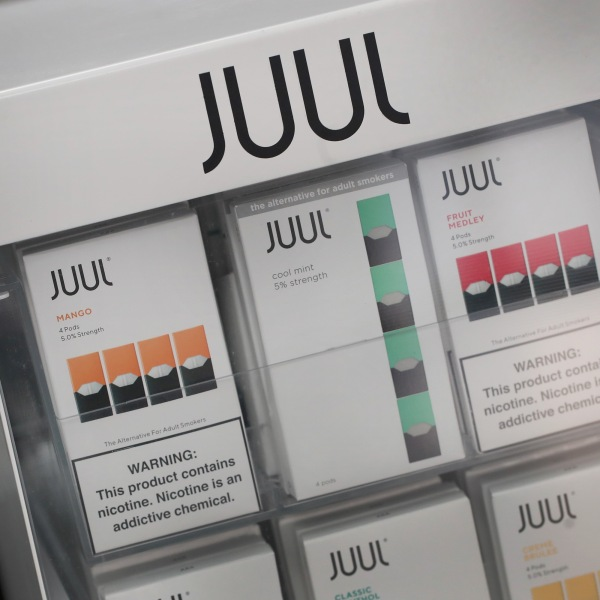 Electronic cigarettes and pods by Juul, the nation's largest maker of vaping products, are offered for sale at the Smoke Depot on September 13, 2018 in Chicago, Illinois. (Credit: Scott Olson/Getty Images)