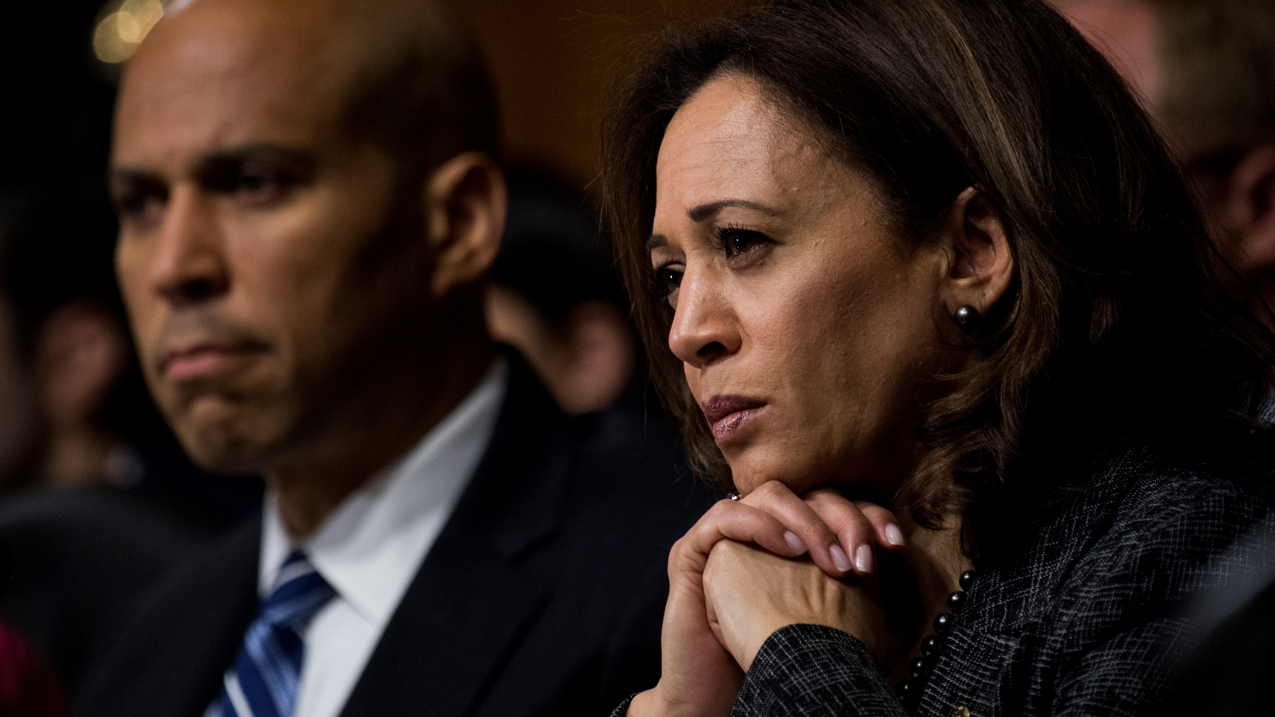 Sen. Cory Booker (D-N.J.) and Sen. Kamala Harris (D-Calif.) listen as Dr. Christine Blasey Ford testifies during the Senate Judiciary Committee hearing on the nomination of Brett M. Kavanaugh to be an associate justice of the Supreme Court of the United States on Capitol Hill Sept. 27, 2018, in Washington, D.C. The two and South Carolina Sen. Tim Scott proposed a bill to outlaw lynching that passed in the Senate on Dec. 19, 2018. (Credit: Tom Williams-Pool/Getty Images)