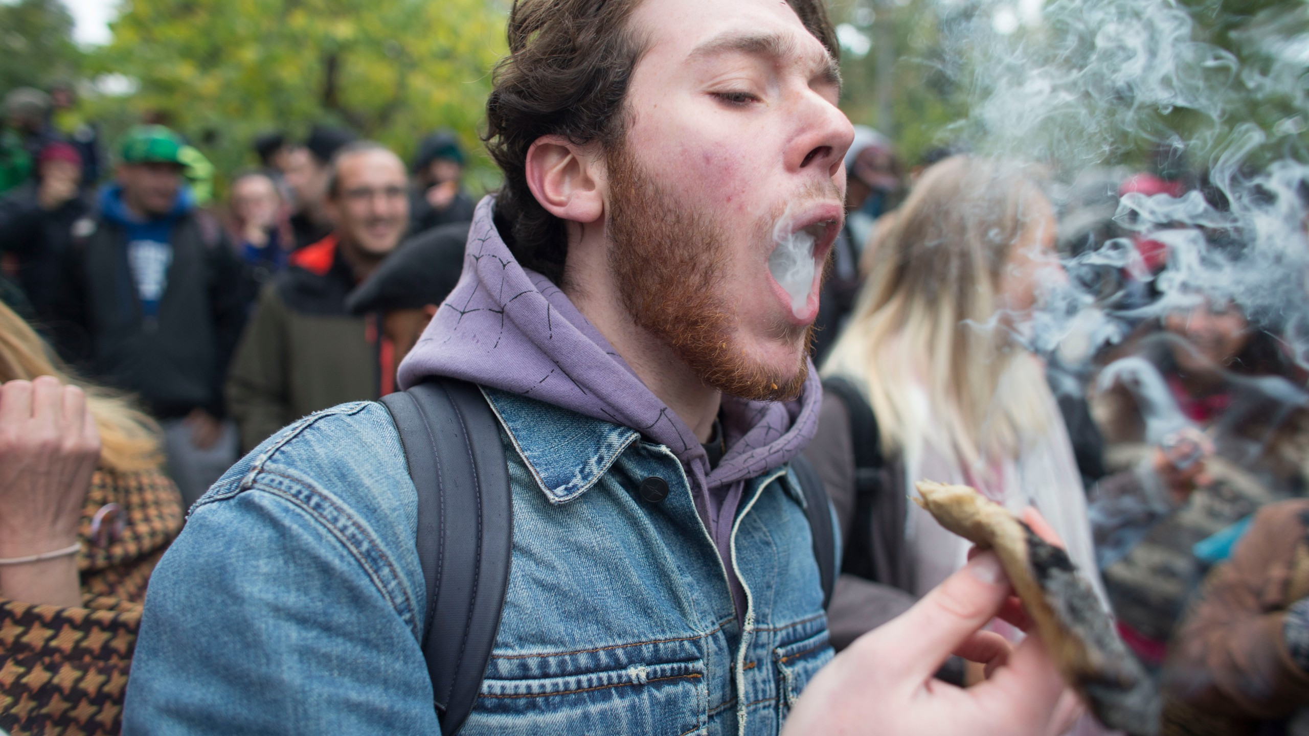 People gather for a marijuana legalization party at Trinity Bellwoods Park in Toronto, Canada, on Oct. 17, 2018. (Credit: Geoff Robins / AFP / Getty Images)