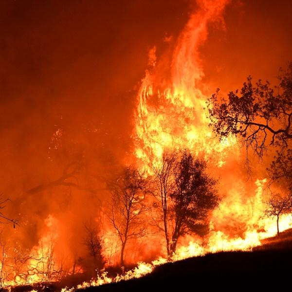 The Woolsey Fire burns through Agoura Hills on Nov. 9, 2018.(Credit: Kevork Djansezian/Getty Images)