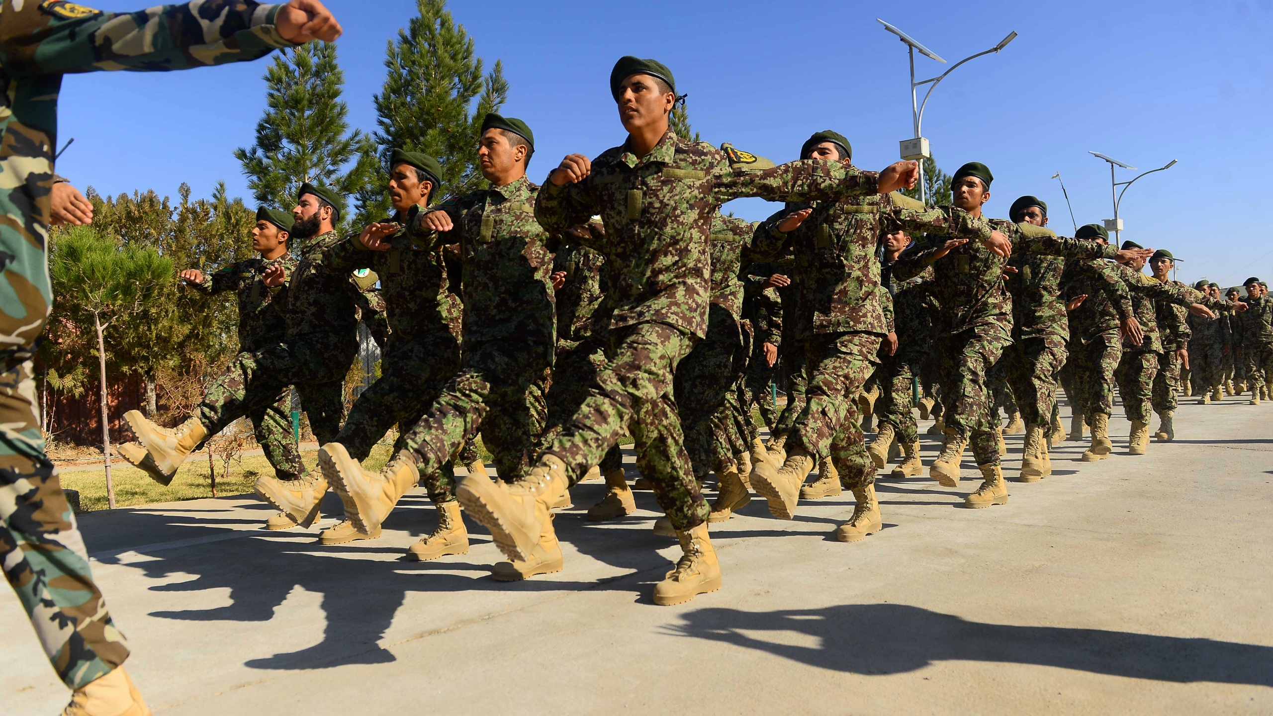 In this photo taken on Nov. 19, 2018, newly-graduated Afghan National Army (ANA) cadets march during a graduation ceremony at the ANA training centre in Herat province. (Credit: HOSHANG HASHIMI/AFP/Getty Images)