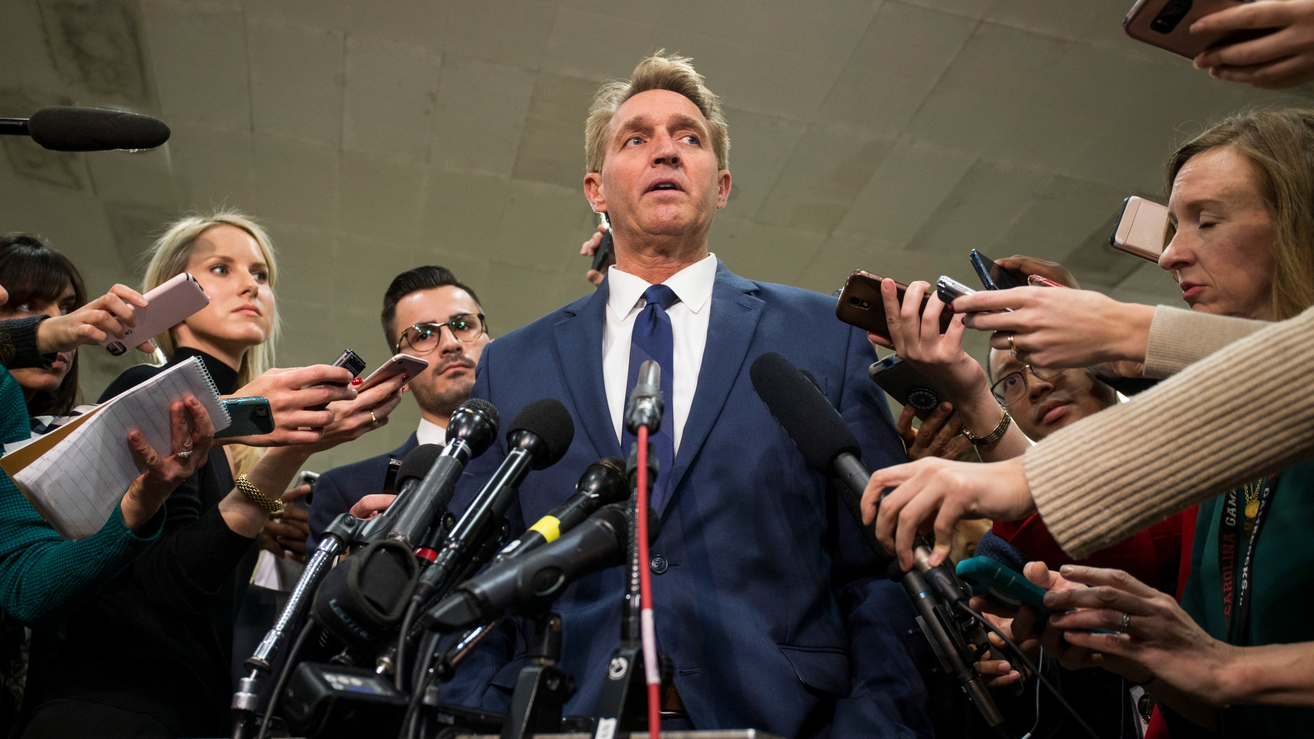 Sen. Jeff Flake (R-AZ) speaks to the press after receiving a briefing from U.S. Secretary of Defense Jim Mattis and U.S. Secretary of State Mike Pompeo on developments in Saudi Arabia on Nov. 28, 2018. (Credit: Zach Gibson/Getty Images)