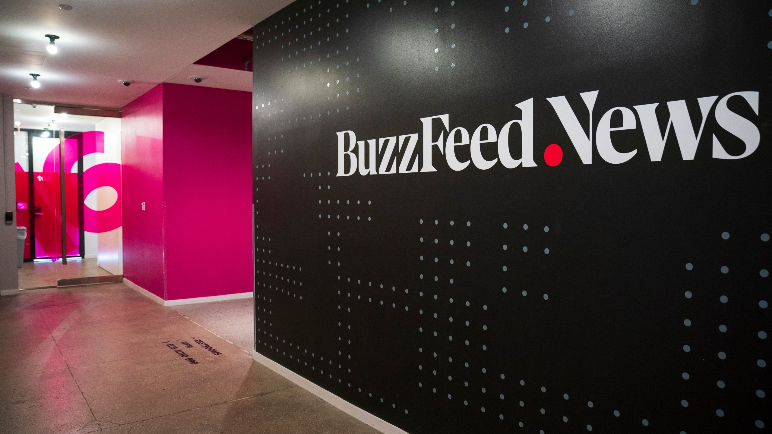 A BuzzFeed News logo adorns a wall inside BuzzFeed headquarters on Dec. 11, 2018 in New York City. (Credit: Drew Angerer/Getty Images)