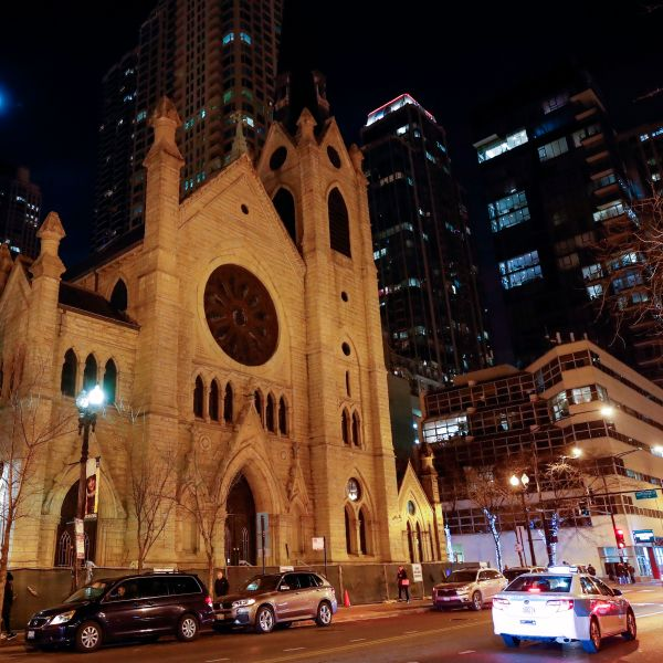 Cars drive past the Holy Name Cathedral in Chicago on Dec. 19, 2018. (Credit: Kamil Krzaczynski / AFP / Getty Images)