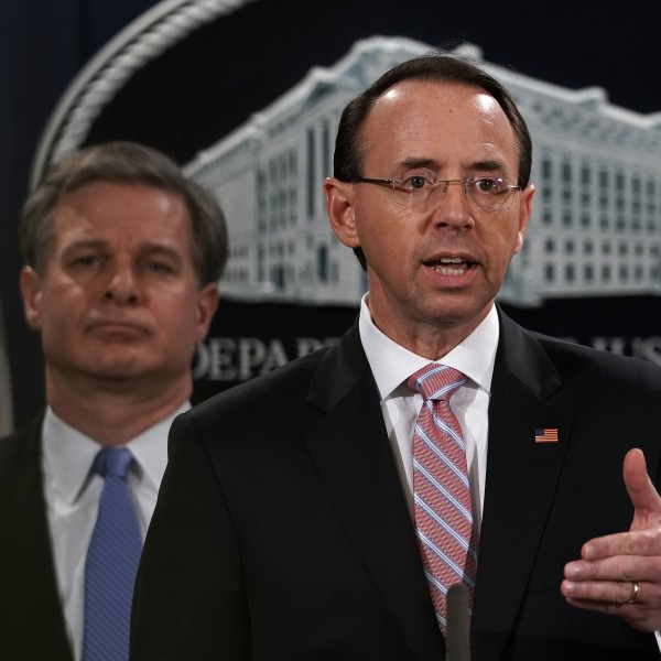U.S. Deputy Attorney General Rod Rosenstein (right) speaks as FBI Director Christopher Wray listens during a news conference to announce a China-related national security law enforcement action on Dec. 20, 2018. (Credit: Alex Wong/Getty Images)