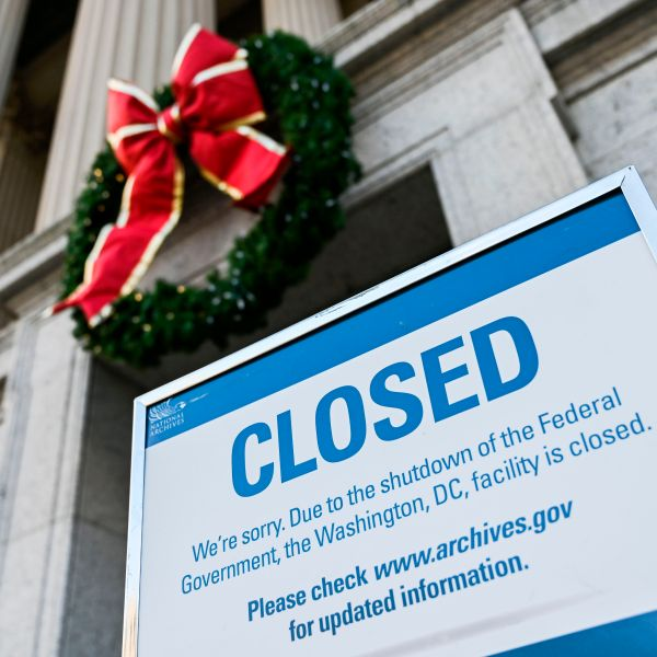 A sign is displayed at the National Archives building that is closed because of a US government shutdown in Washington, DC, on December 22, 2018. - The partial US government shutdown is set to stretch on through Christmas as the Senate adjourned with no deal to end it in sight. (Credit: ANDREW CABALLERO-REYNOLDS/AFP/Getty Images)