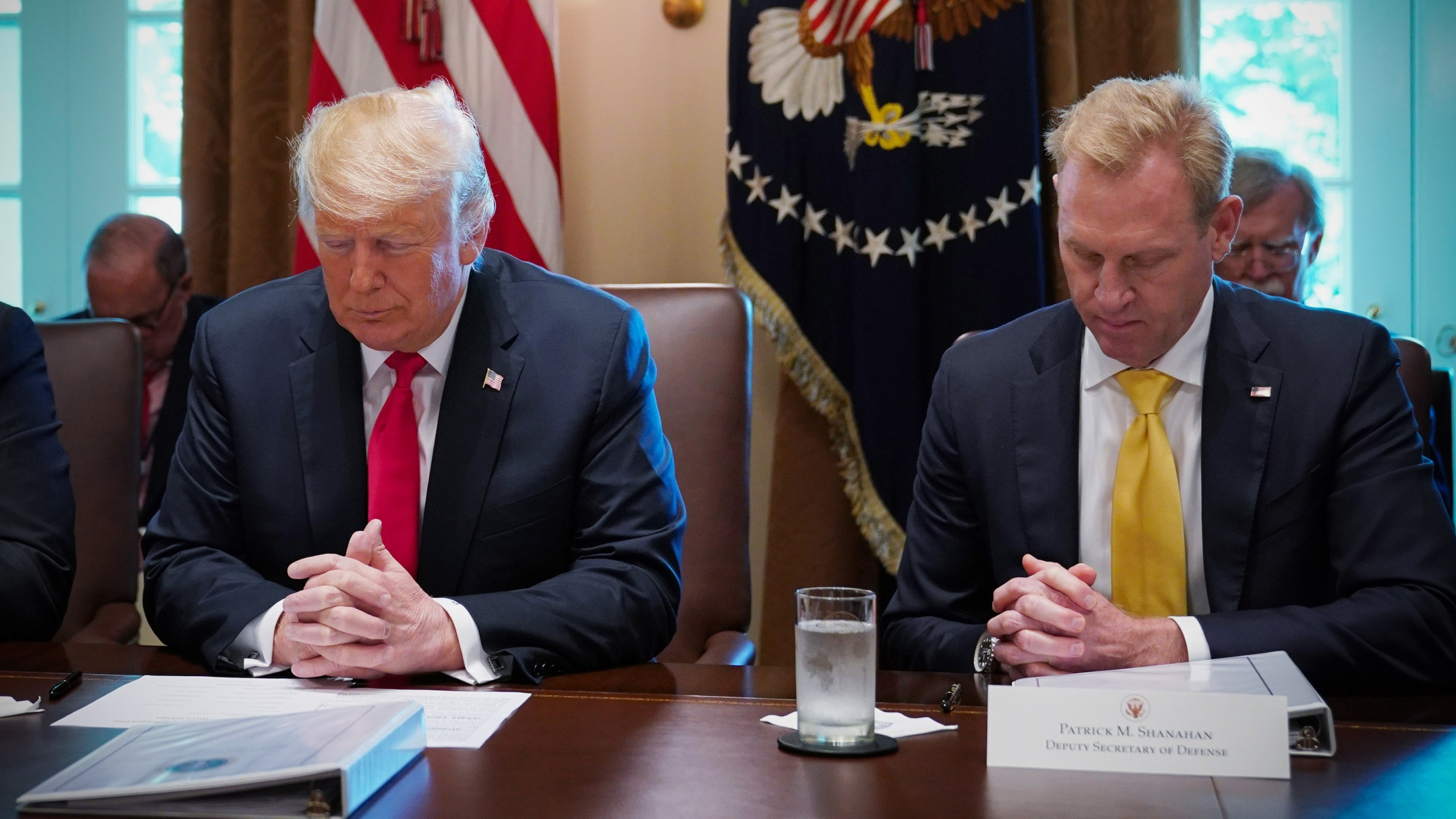 Donald Trump and Patrick Shanahan bow their heads in prayer before the start of a Cabinet meeting in the Cabinet Room of the White House on Aug. 16, 2018. (Credit: MANDEL NGAN/AFP/Getty Images)