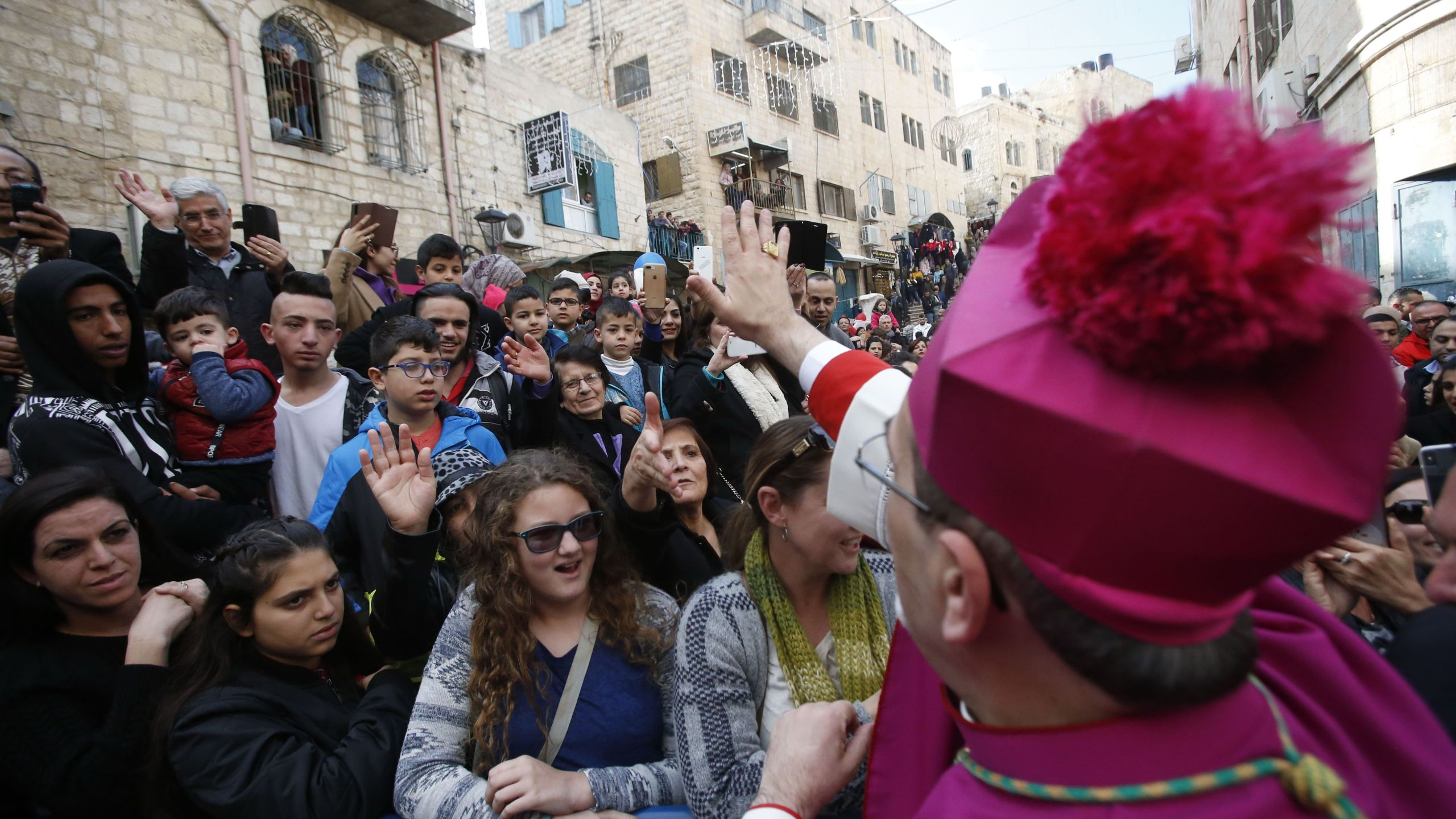 Latin Patriarch of Jerusalem Pierbattista Pizzaballa greets a crowd as he arrives in the West Bank city of Bethlehem, on Dec. 24, 2018. (Credit: HAZEM BADER/AFP/Getty Images)