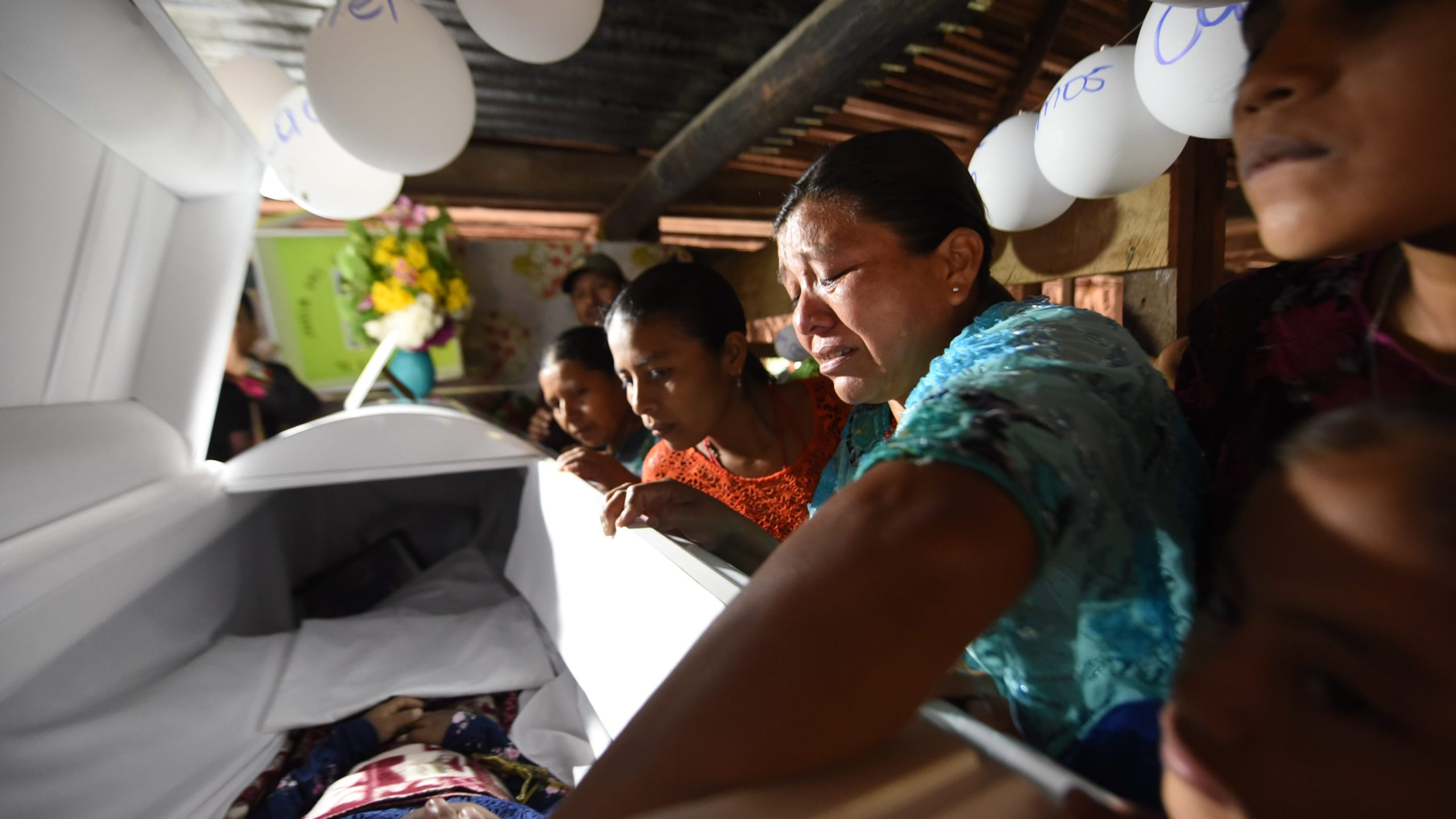 Relatives cry over the coffin of 7-year old Jakelin Caal during a wake in her home village 320 kilometers north of Guatemala City on Dec. 24, 2018. (Credit: JOHAN ORDONEZ/AFP/Getty Images)