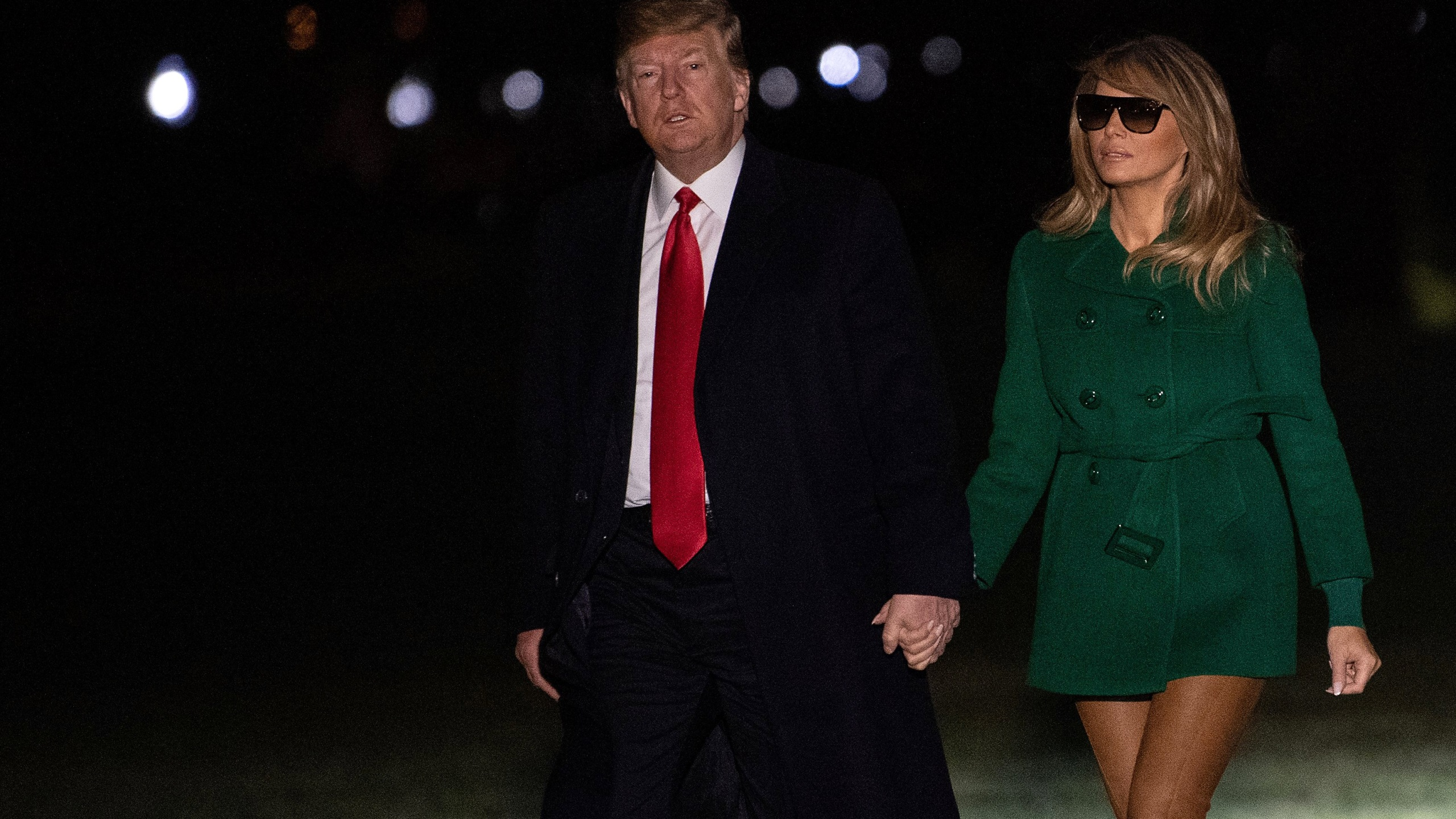 US President Donald Trump and First Lady Melania Trump arrive at the White House in Washington, DC, on December 27, 2018, as they return from an unannounced trip to Iraq. (Credit: NICHOLAS KAMM/AFP/Getty Images)