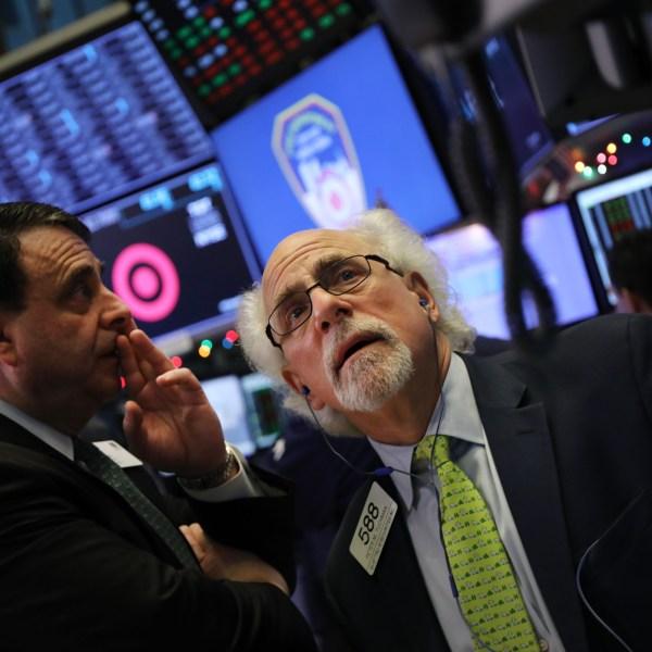 Traders work on the floor of the New York Stock Exchange on Dec. 21, 2018. (Credit: Spencer Platt / Getty Images)