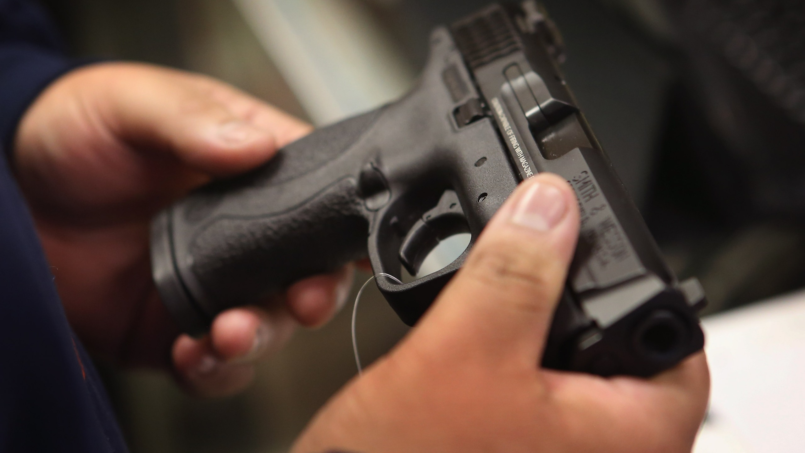 A person holds a pistol in this file photo. (Credit: Scott Olson/Getty Images)