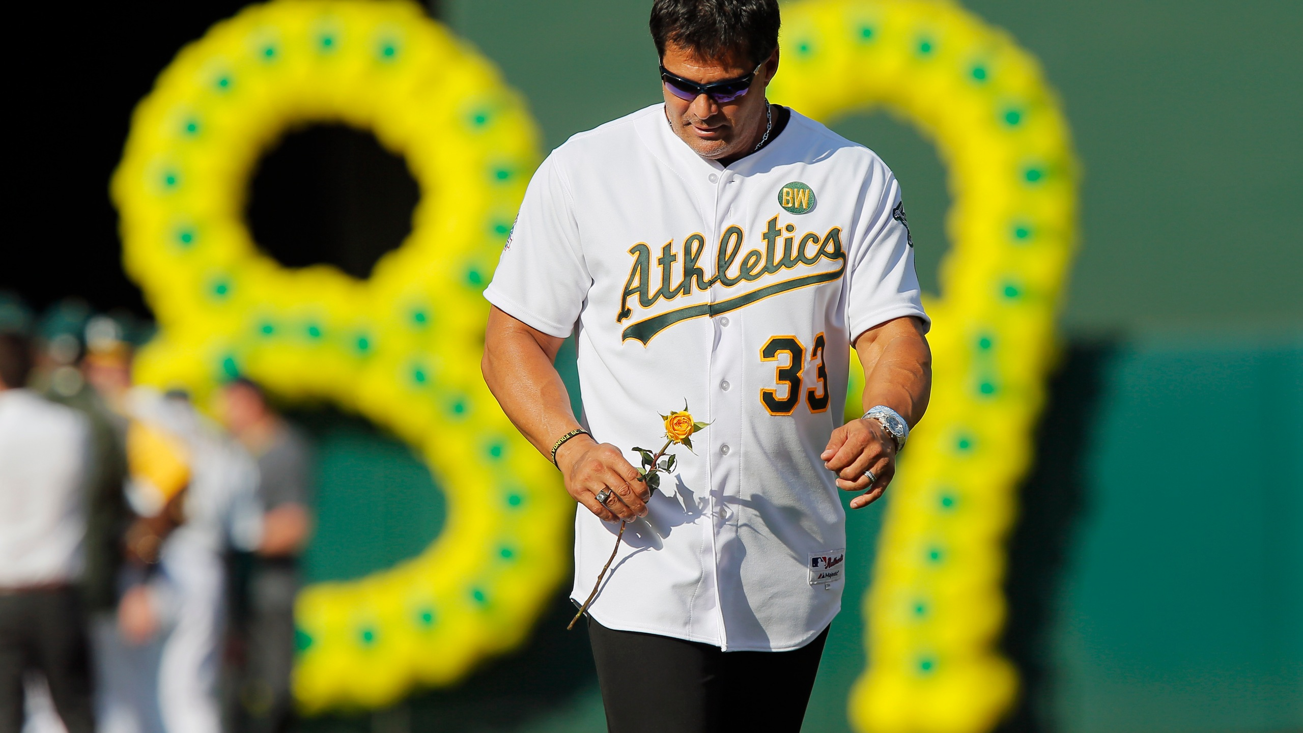 Jose Canseco of the 1989 Oakland A's joins his teammates as they celebrate their World Series championship 25 years ago on July 19, 2014 in Oakland. (Credit: Brian Bahr/Getty Images)