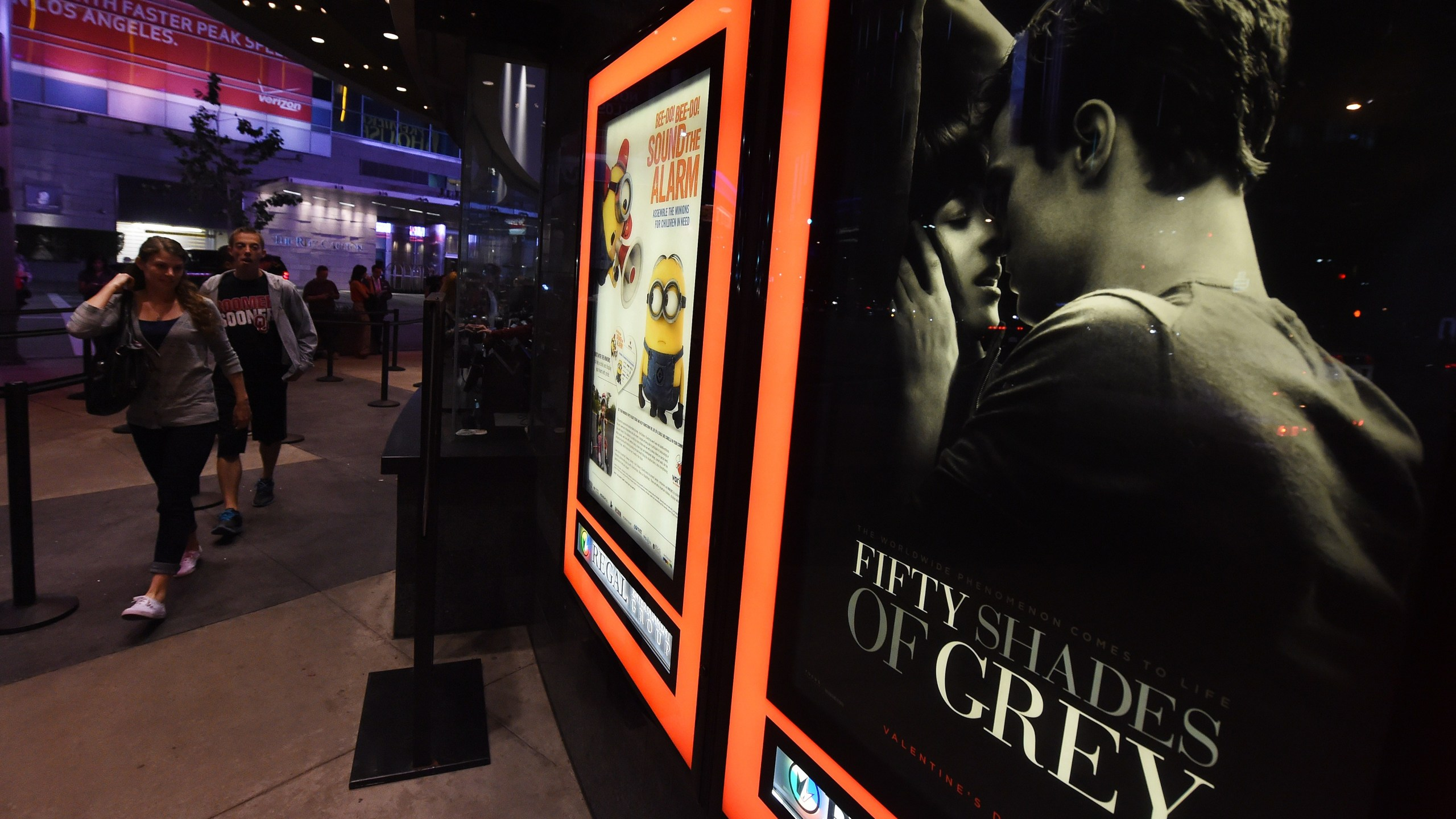"""People arrive to watch the film """"Fifty Shades of Grey"""" on its opening day in Los Angeles on Feb. 12, 2015. (Credit: Mark Ralston / AFP / Getty Images)"""