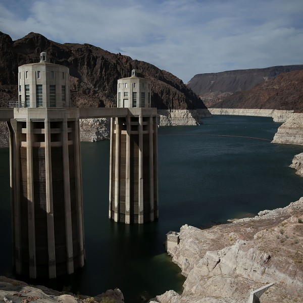 A tall bleached 'bathtub ring' is visible on the steep rocky banks of Lake Mead at the Hoover Dam on May 12, 2015 in Lake Mead National Recreation Area, Arizona. (Credit: Justin Sullivan/Getty Images)
