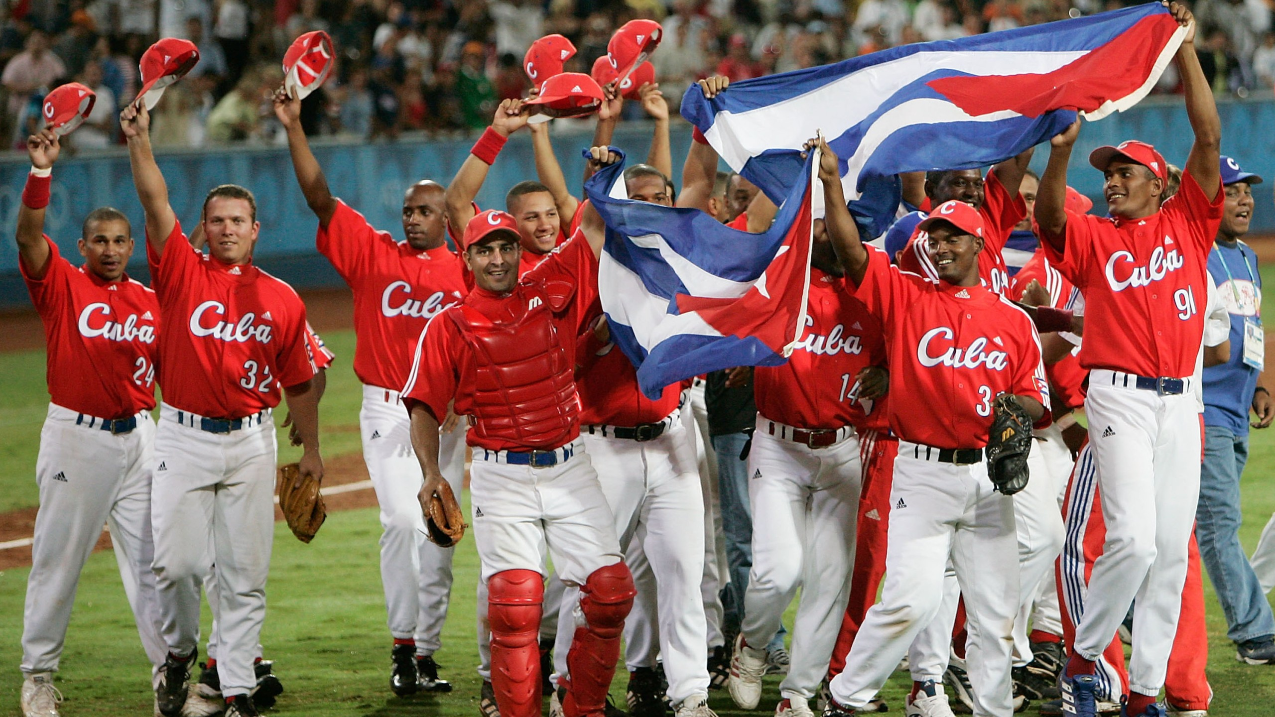 Cuba celebrates their victory over Australia in the gold medal baseball game on August 25, 2004 during the Athens 2004 Summer Olympic Games at the Baseball Centre in the Helliniko Olympic Complex in Athens, Greece. (Credit: Donald Miralle/Getty Images)