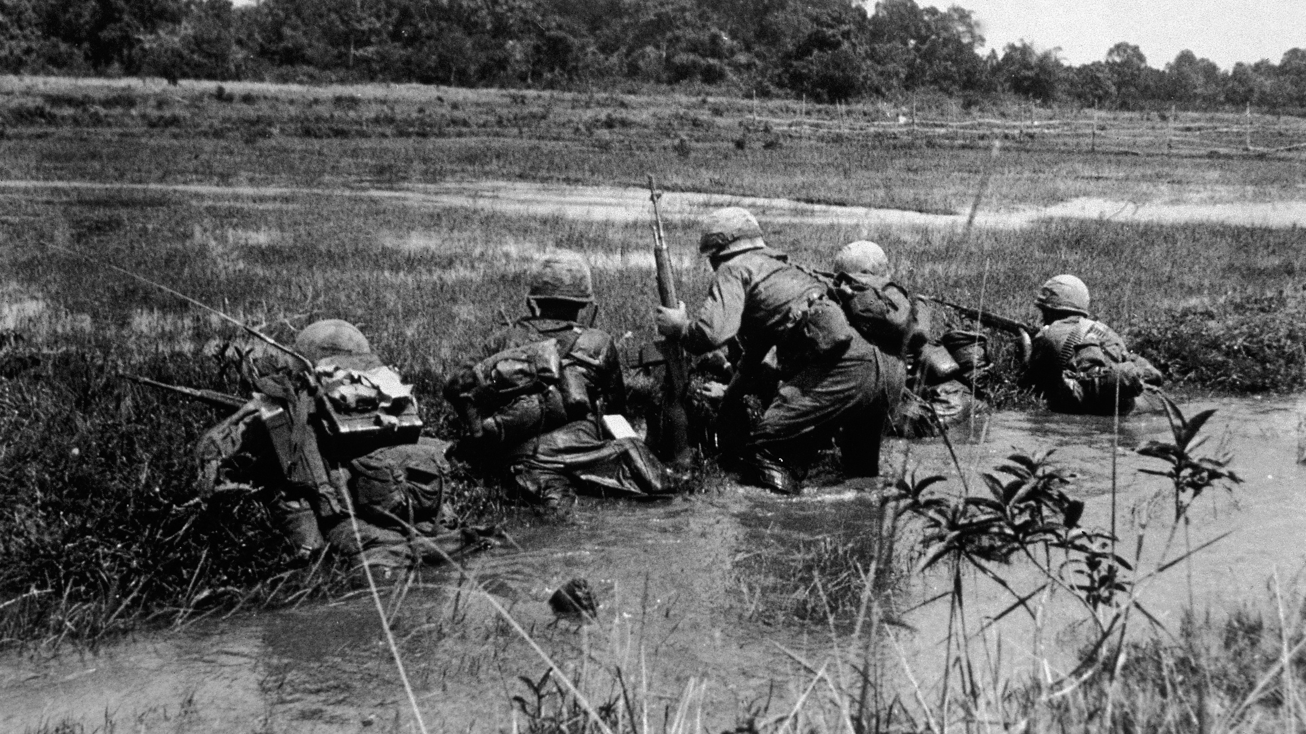 American army combat platoon leader Second Lieutenant John Libs (center) of 2nd platoon, C Company, 2d Battalion, 16th Infantry Regiment, 1st Division, surveys the situation in Vietnam, mid 1960s. (Credit: Hulton Archive/Getty Images)