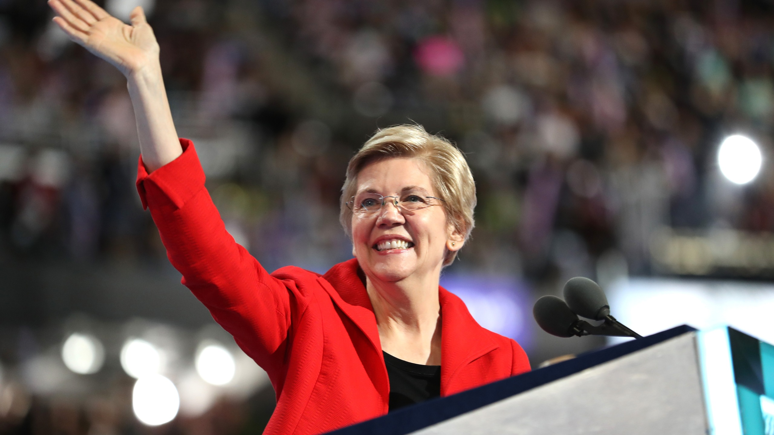 Sen. Elizabeth Warren acknowledges the crowd as she walks on stage to deliver remarks on the first day of the Democratic National Convention at the Wells Fargo Center, July 25, 2016 in Philadelphia, Pennsylvania. (Credit: Joe Raedle/Getty Images)