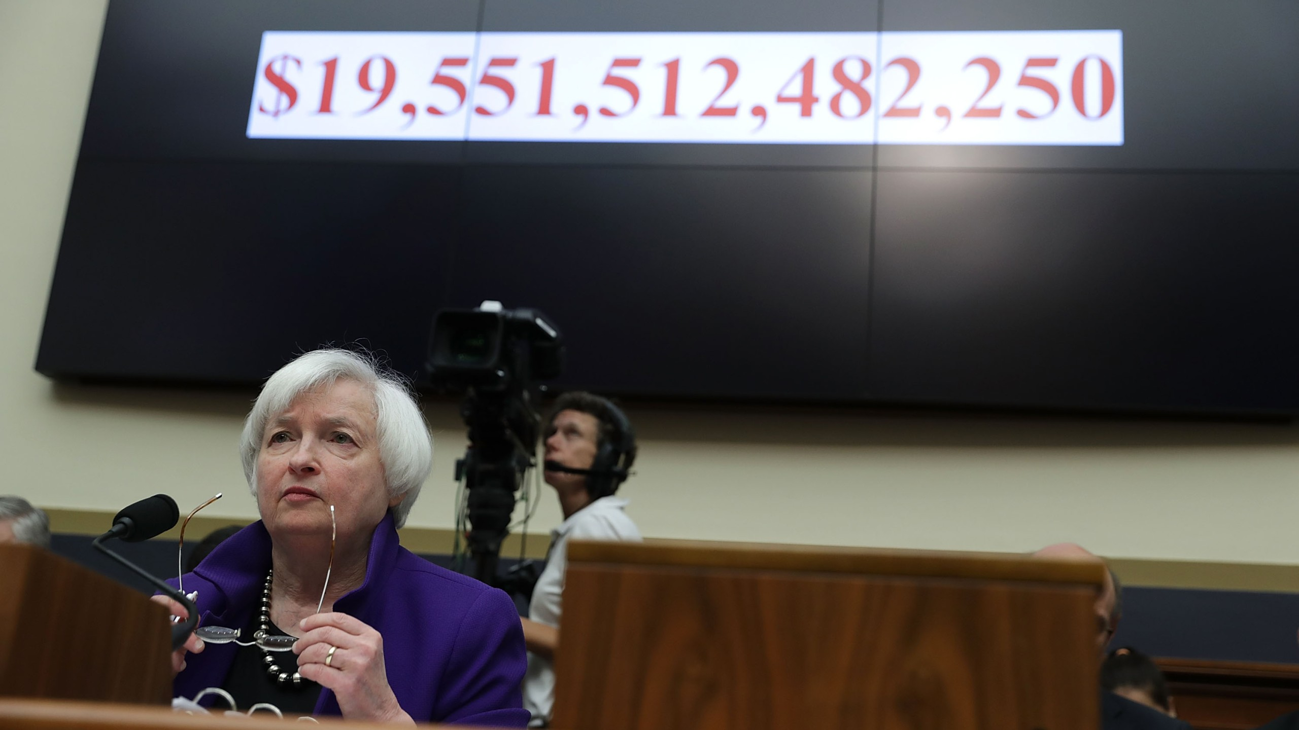 As the number of the current U.S. national debt is seen on a screen, Federal Reserve Board Chair Janet Yellen testifies during a hearing before the House Financial Services Committee September 28, 2016 on Capitol Hill in Washington, DC. (Credit: Alex Wong/Getty Images)