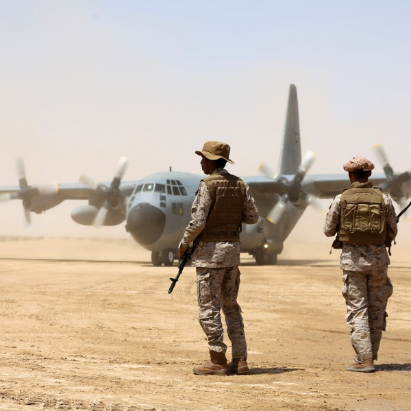 Saudi soldiers stand guard before aid supplies are unloaded from a Saudi air force cargo plane at an airfield in Yemen's central province of Marib, on March 12, 2018.( Credit: Abdullah Al-Qadry/AFP/Getty Images)
