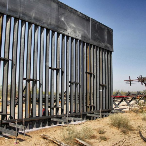 U.S. workers are photographed during construction of 32km of the border wall by order of President Donald Trump on the border between Ciudad Juarez, Chihuahua state, Mexico and Santa Teresa, New Mexico state, US, on April 17, 2018. (Credit: HERIKA MARTINEZ/AFP/Getty Images)