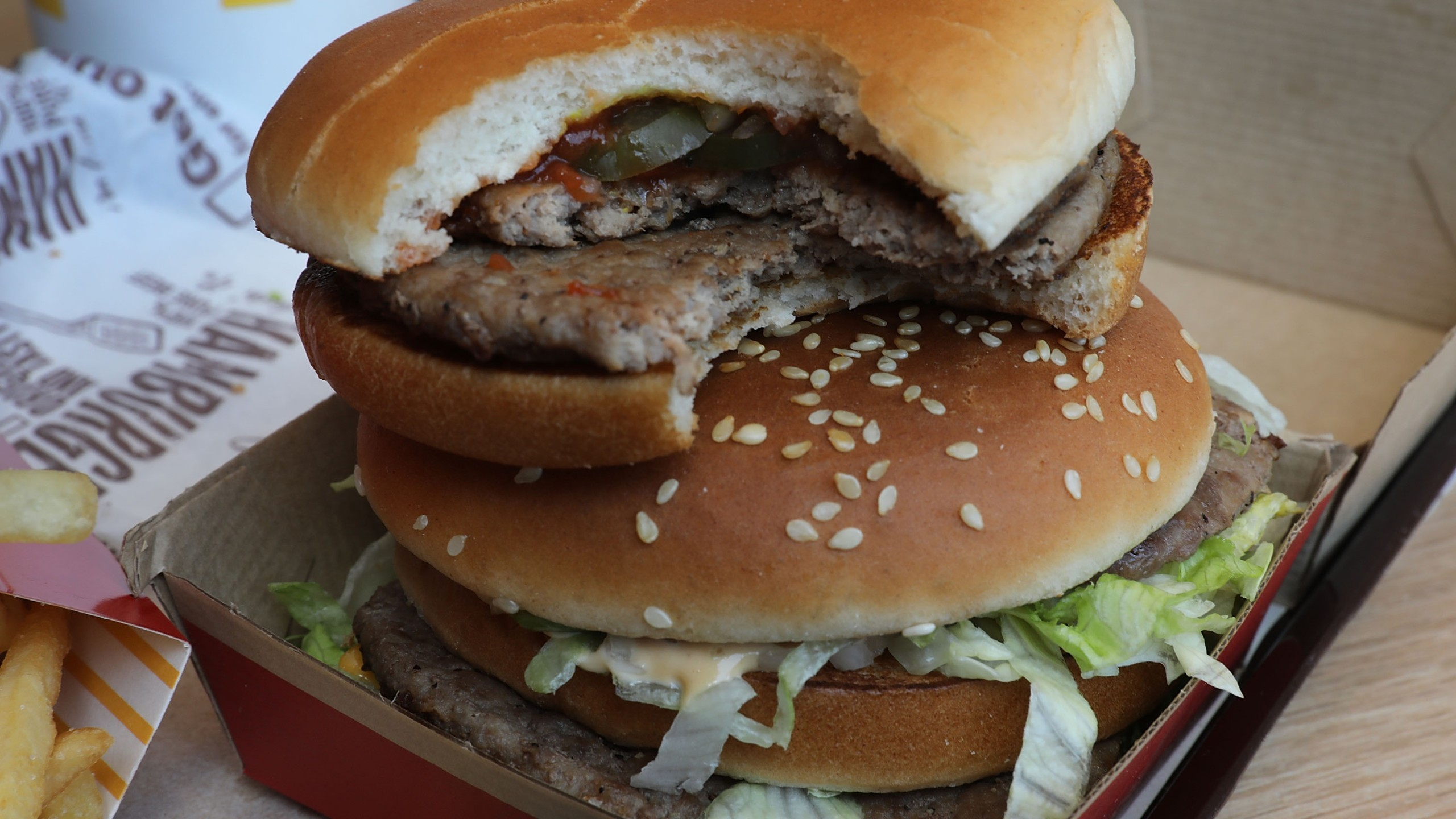 AMcDonald's Big Mac and double hamburger are seen on a tray in a file photo on April 30, 2018. (Credit: Joe Raedle/Getty Images)