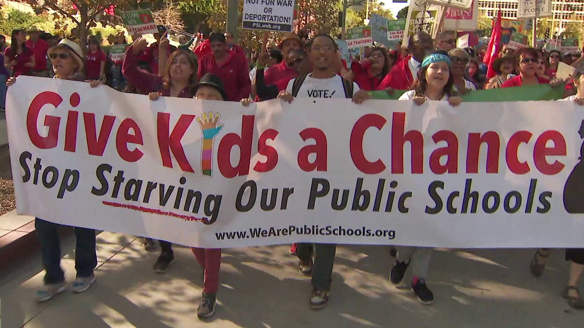 Protesters are seen rallying in support of higher wages for teachers in Los Angeles on Dec. 16, 2018. (Credit: KTLA)