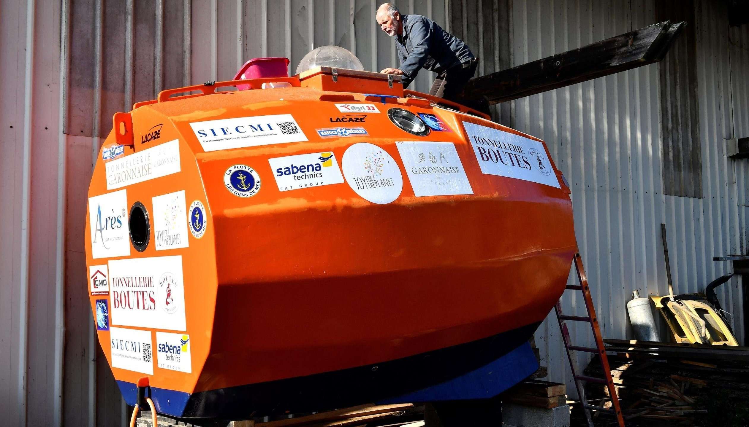 A 71-year-old Frenchman has set sail across the Atlantic Ocean in a large orange barrel in late December 2018, hoping to float to the Caribbean by the end of March 2019. (Credit: Georges Gobet/AFP/Getty Images via CNN)