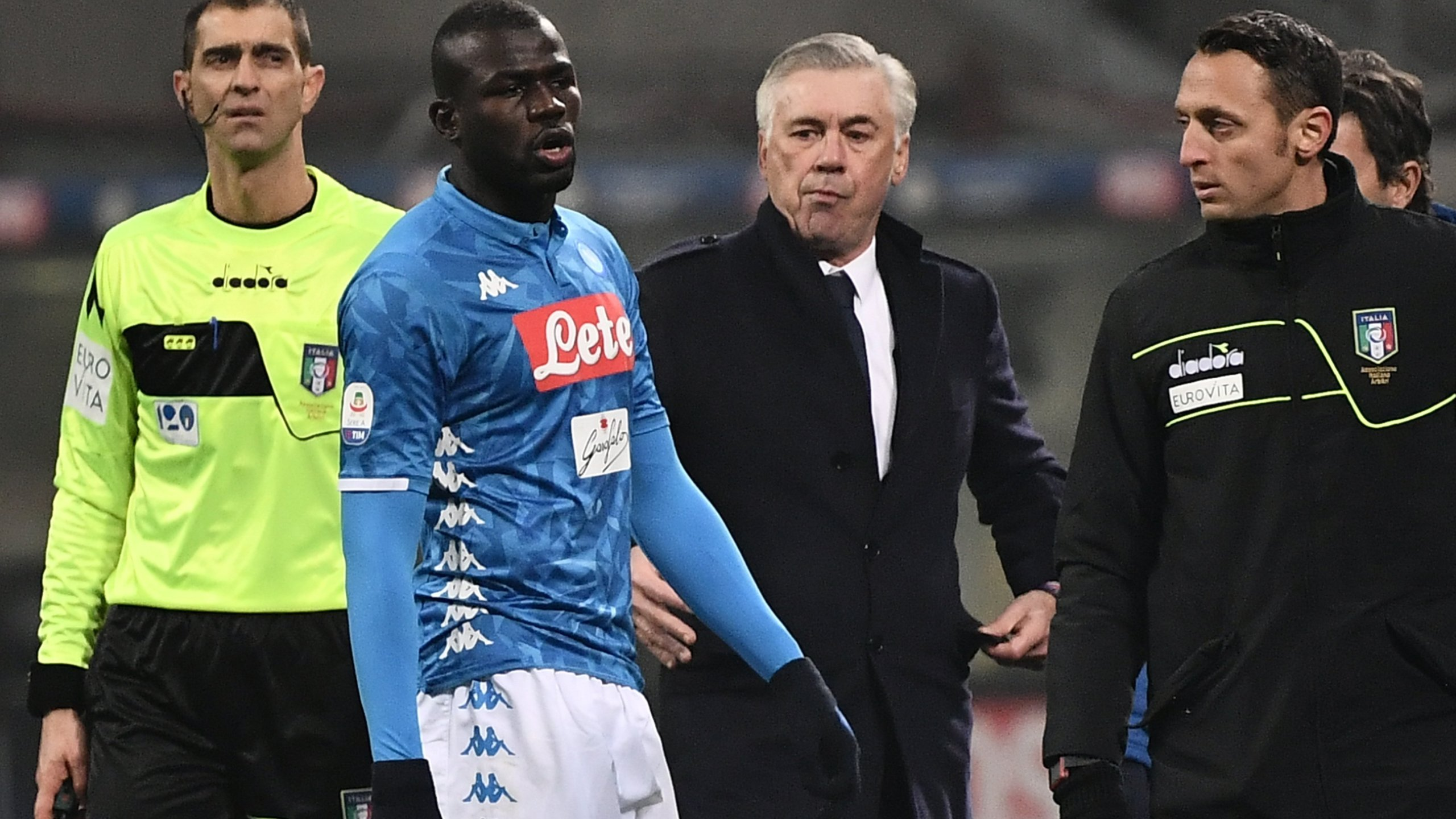 Kalidou Koulibaly leaves the pitch after receiving a red card in the game against Inter. Napoli coach Carlo Ancelotti says the next time a member of his team is racially abused the way Koulibaly was, he'd be happy for the Serie A side to stop playing. (Credit: Marco Bertorello AFP/Getty Images via CNN)
