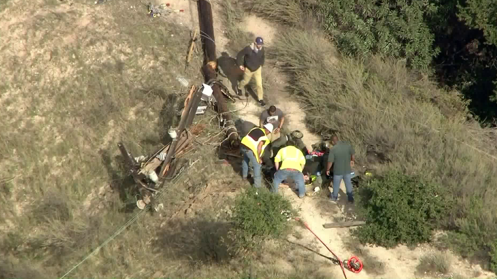 A utility pole fell in Lopez Canyon on Dec. 17, 2018, injuring two workers, authorities say. (Credit: KTLA)