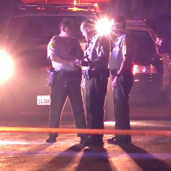 Los Angeles County Sheriff's Department deputies investigate a shooting at Pioneer Park in San Dimas on Dec. 23, 2018. (Credit: OC HAWK)