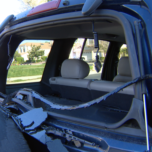 The back windshield of a vehicle is seen shattered in the Rancho Conejo community of Newbury Park on Dec. 16, 2018. (Credit: KTLA)