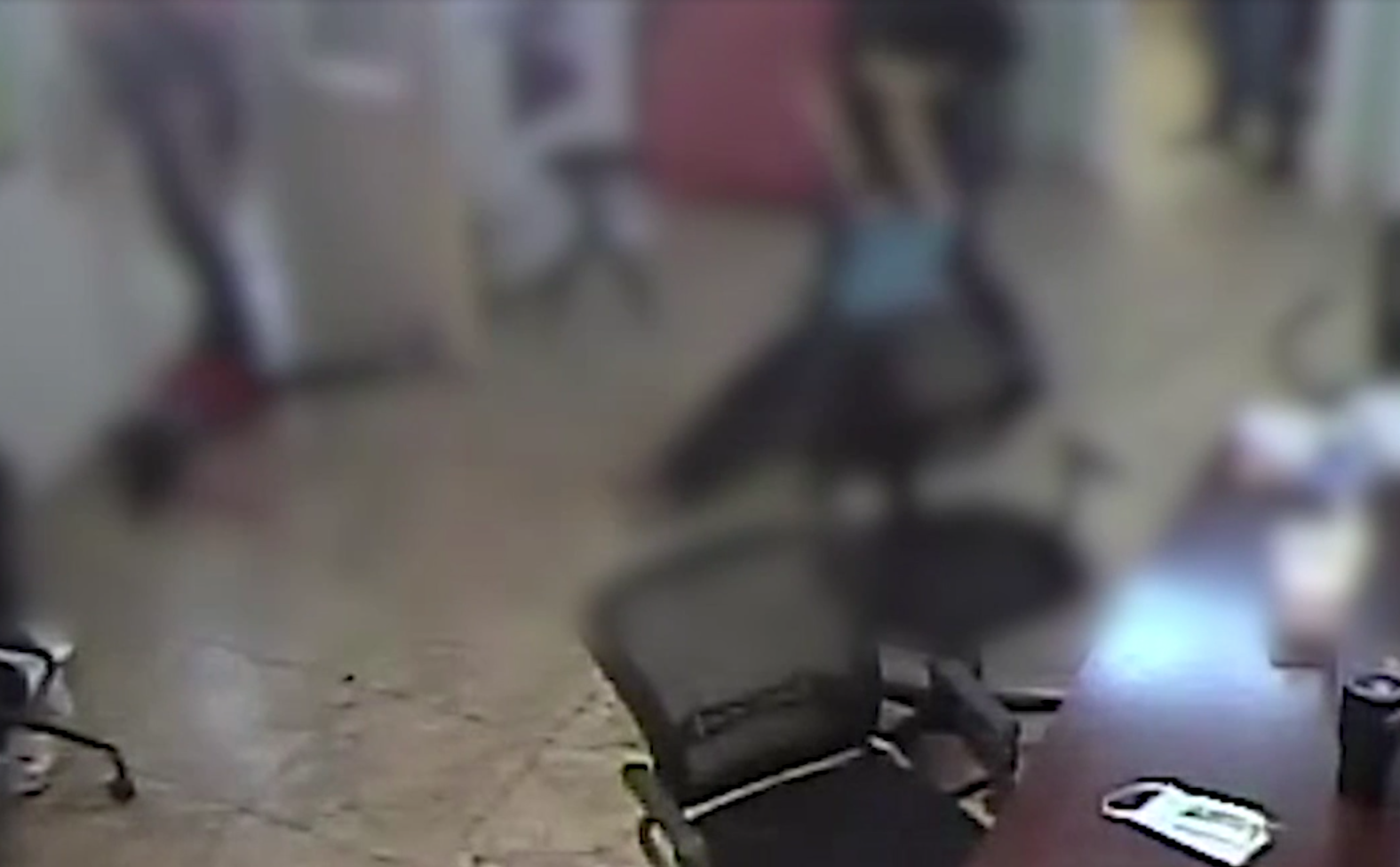 A blurred still from a video obtained by the Arizona Republicthrough an open records request shows a Southwest Key shelter staffer apparently dragging a migrant child.