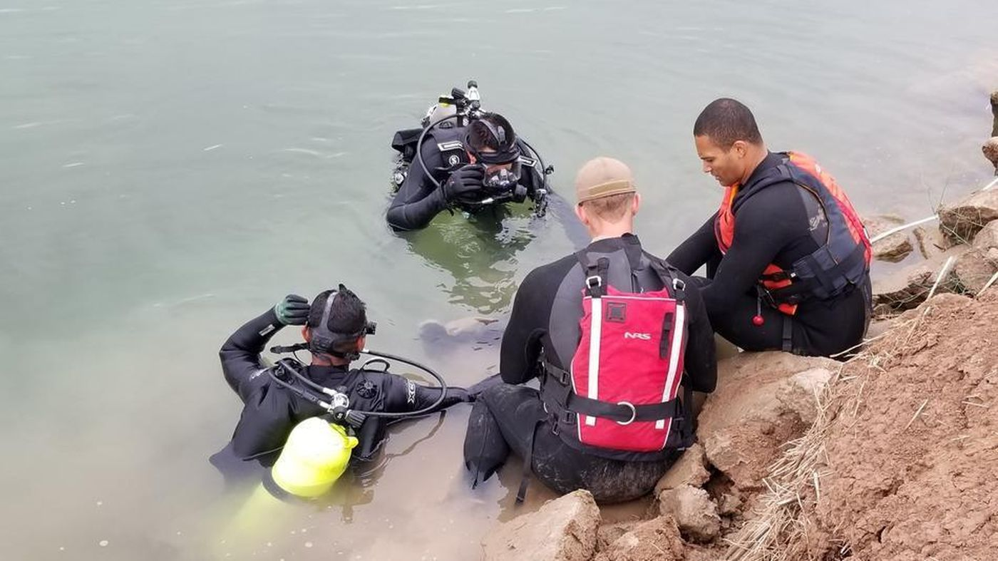 Border Patrol divers search the All-American Canal for the body of a migrant who drowned on Dec. 5, 2018 after crossing the border illegally in Calexico. (Credit: Border Patrol)