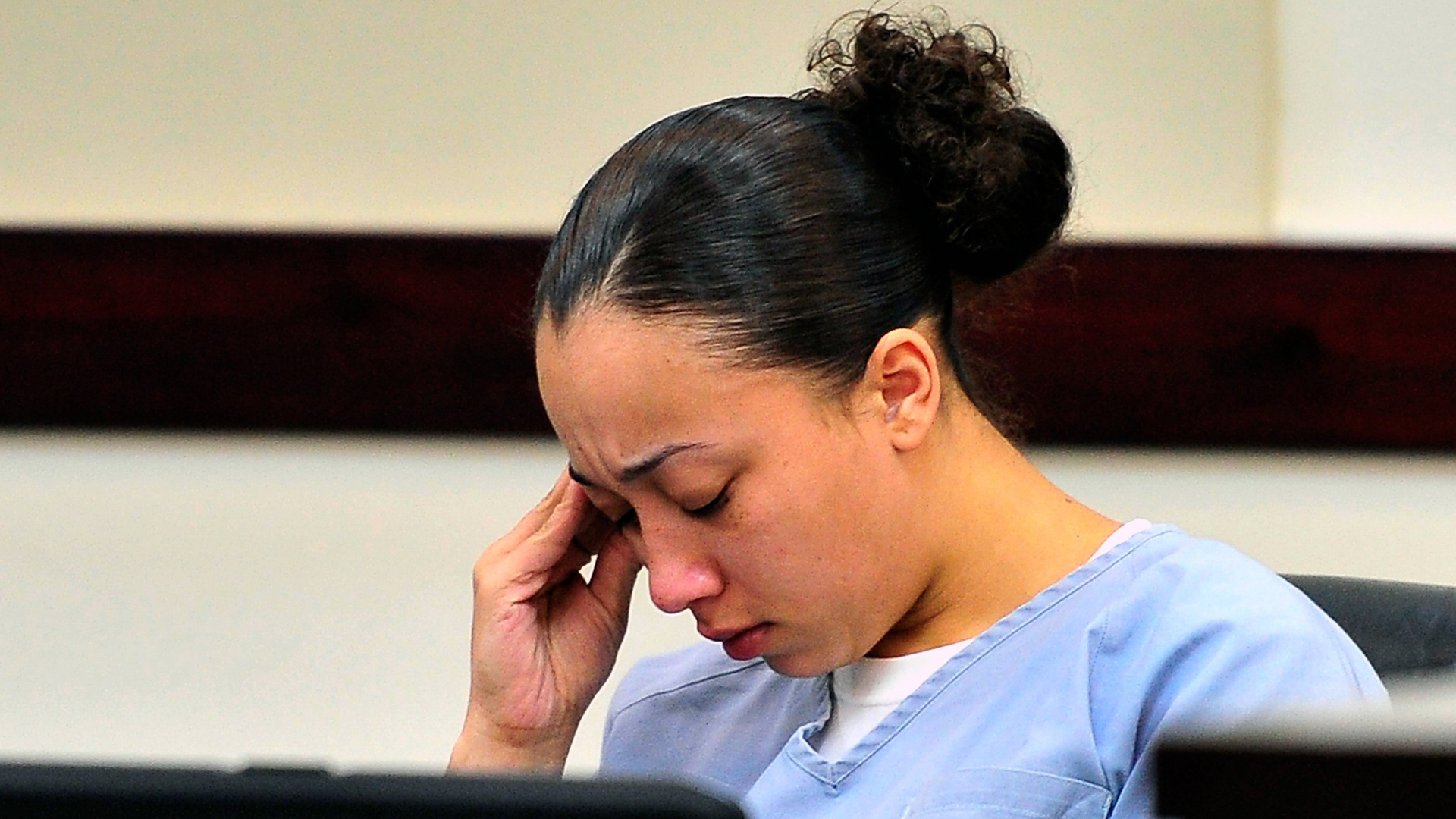 Cyntoia Brown, a woman who was 16 when she killed a Nashville man who solicited her for sex, must serve at least 51 years in prison before she's eligible for release, according to the Tennessee Supreme Court. She is seen in court in this undated photo. (Credit: Jae S. Lee/AP via CNN)