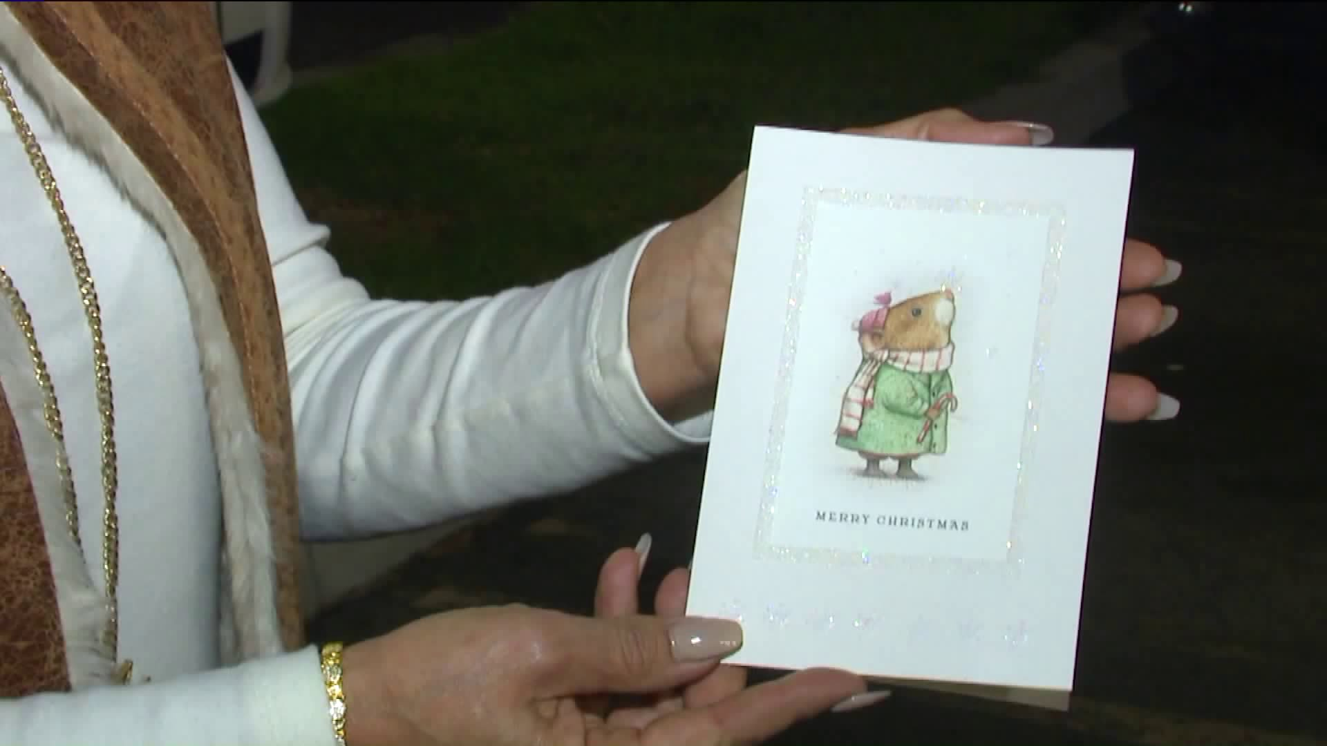 A church group is searching for the rightful recipient of a card someone dropped in a vehicle at Polly's Pies in Cerritos. (Credit: KTLA)
