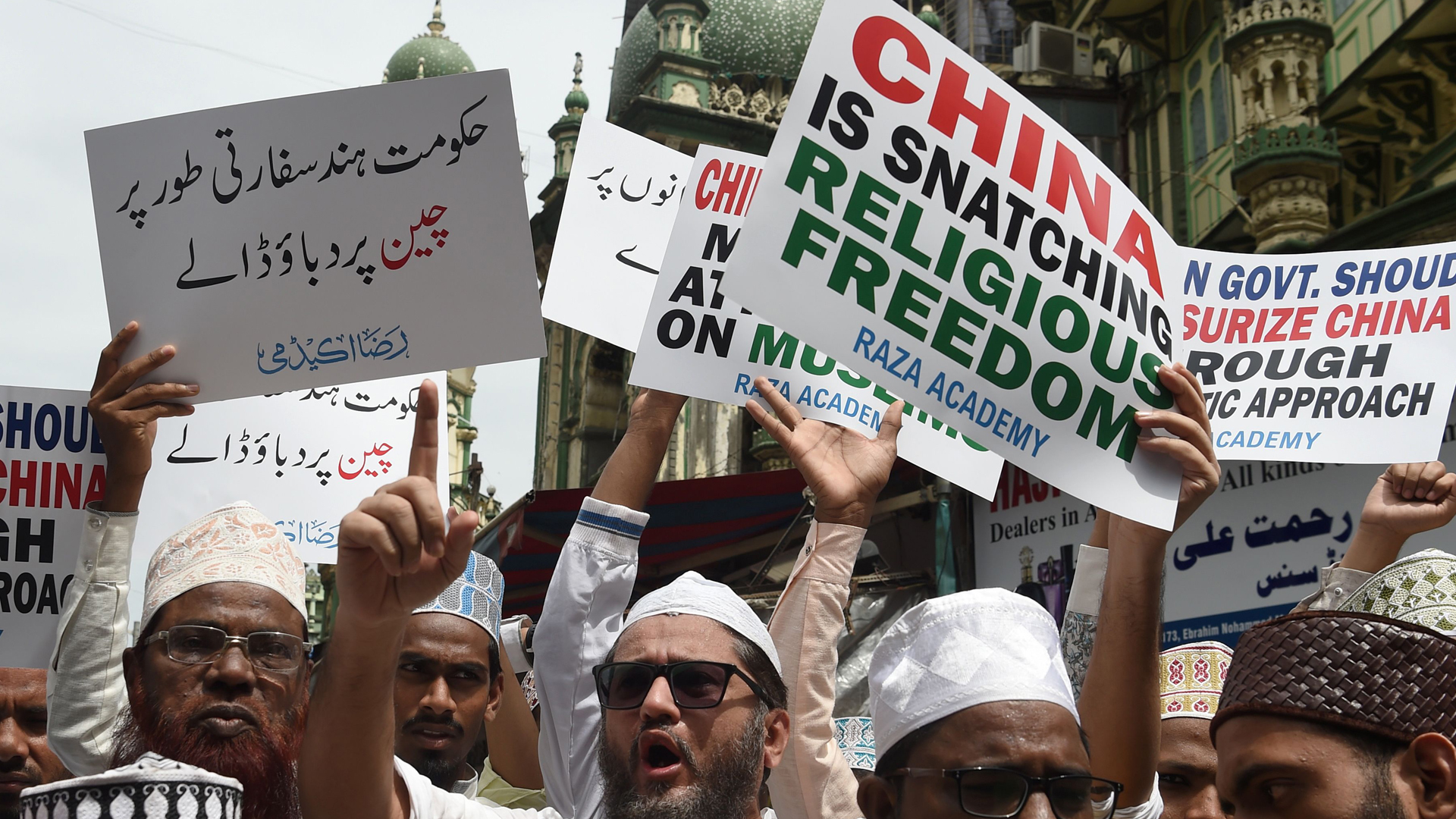 Indian Muslims hold signs during a protest against the Chinese government over the detention of Muslim minorities in Xinjiang, in Mumbai on Sept. 14, 2018. (Credit: PUNIT PARANJPE/AFP/Getty Images)