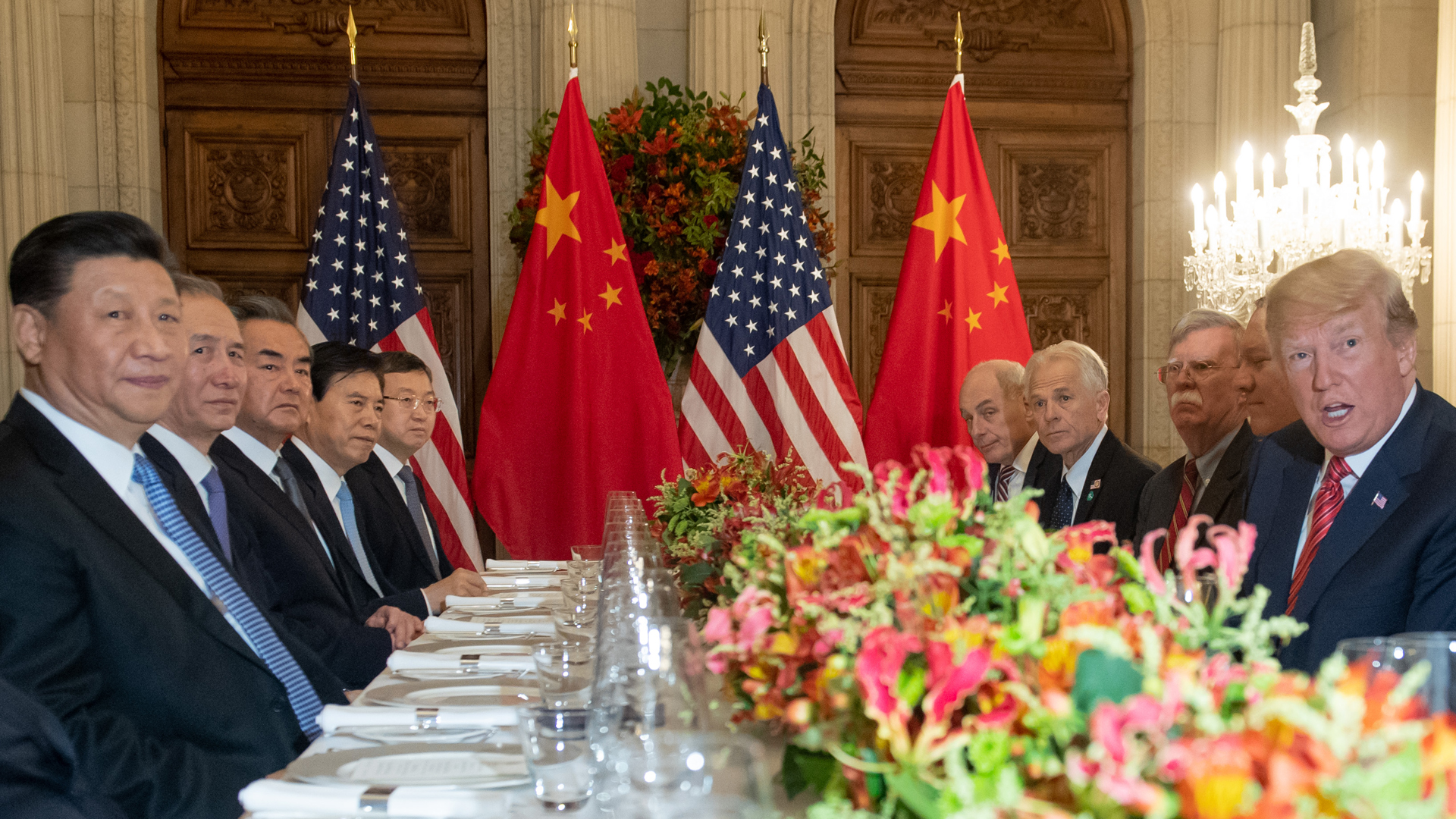 U.S. President Donald Trump and China's President Xi Jinping, along with members of their delegations, hold a dinner meeting at the end of the G20 Leaders' Summit in Buenos Aires, on Dec. 1, 2018. (Credit: SAUL LOEB/AFP/Getty Images)