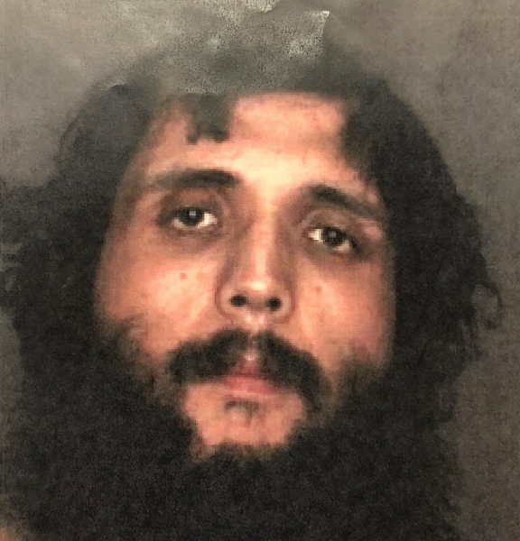 A man suspected of critically injuring an Upland woman during an attempted break-in is seen in an image provided by the Upland Police Department.