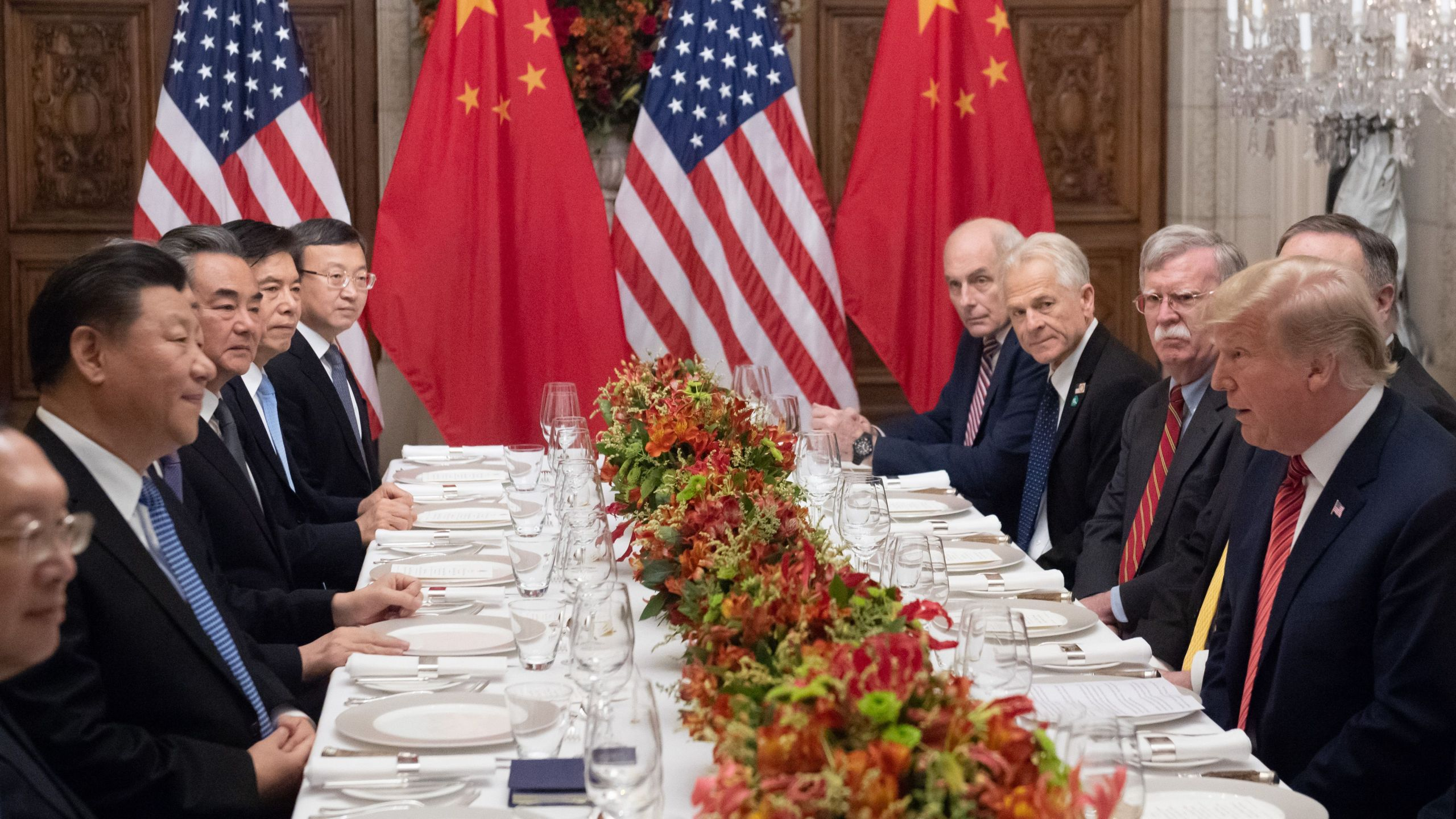 US President Donald Trump (R) and China's President Xi Jinping (L) along with members of their delegations, hold a dinner meeting at the end of the G20 Leaders' Summit in Buenos Aires, on December 01, 2018. (Credit: Saul Loeb/AFP/Getty Images)