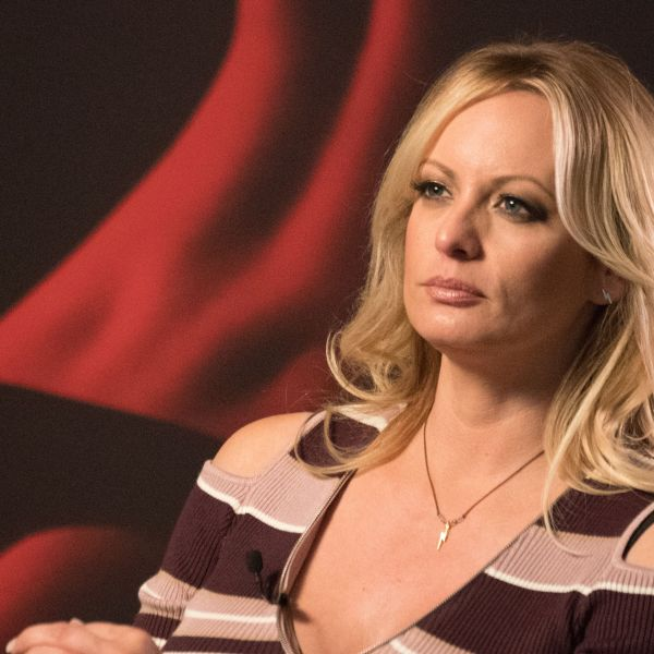 Stormy Daniels talks with a journalist during an interview in Berlin, Germany, on October 11, 2018. (Credit: Ralf Hirschberger/AFP/Getty Images)
